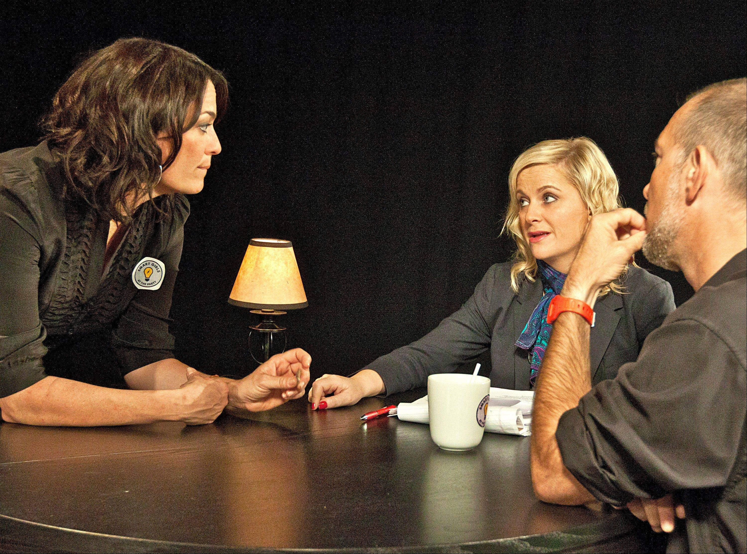 "This undated image released by ""Smart Girls at the Party,"" shows Meredith Walker, left, Amy Poehler and director David Karabinas on the set of ""Smart Girls at the Party,"" the flagship show for the YouTube channel, and founded by Amy Poehler. ""Smart Girls at the Party"" is one of the latest channels to launch on YouTube with funding from the Google video-sharing site."