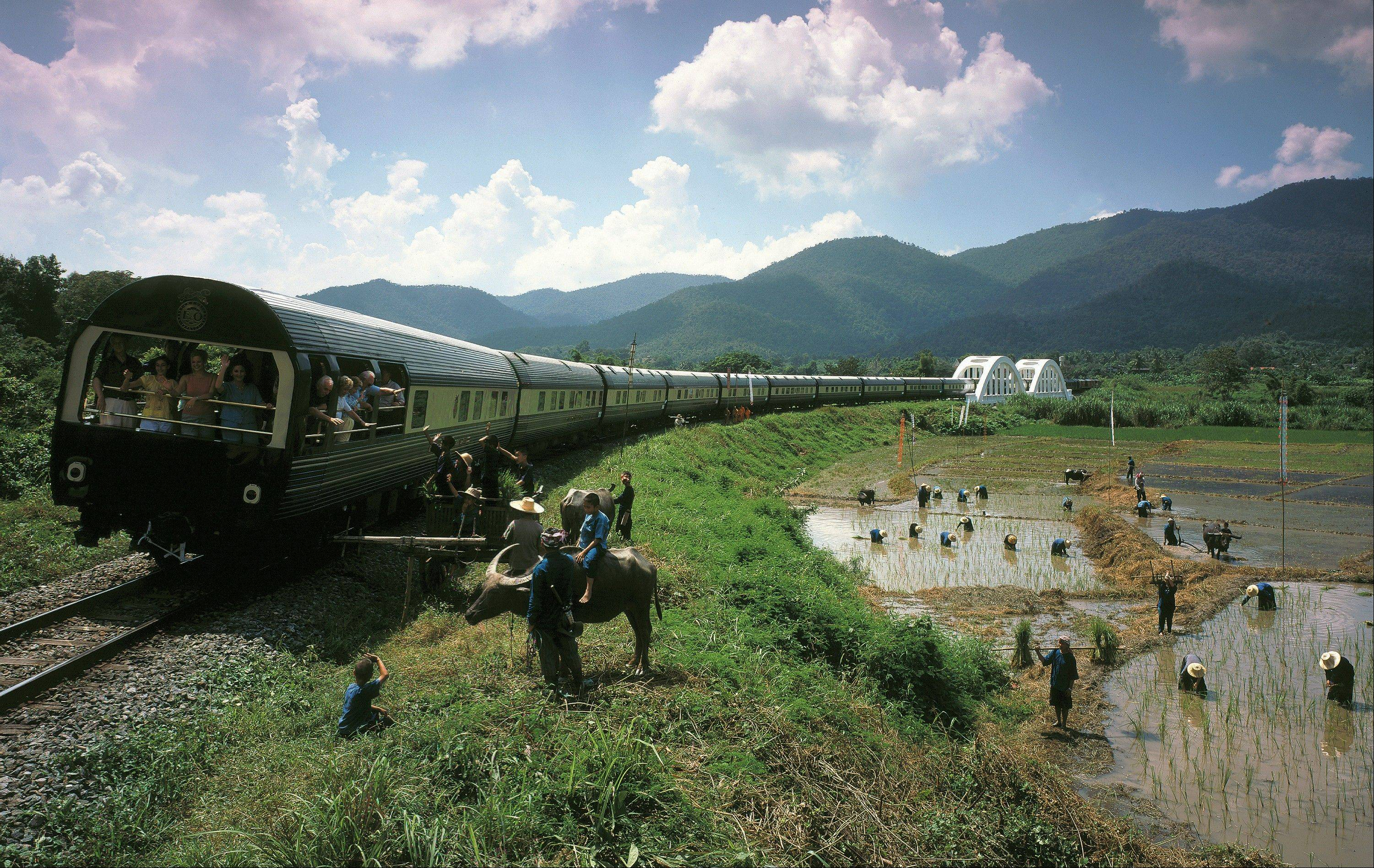An Eastern & Oriental train crosses the Tha Chompu Bridge near Chiang Mai in Thailand.