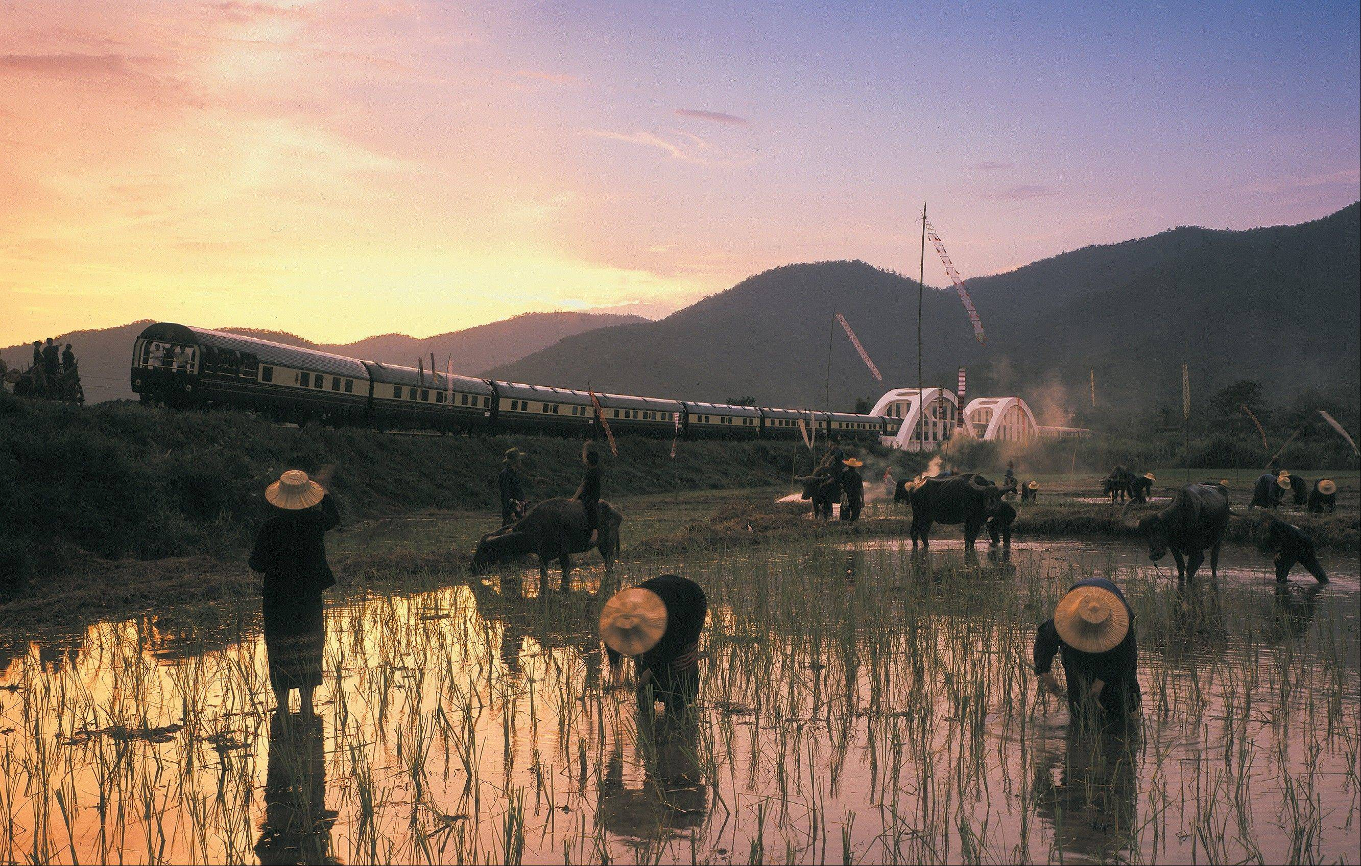 The Eastern & Oriental train crosses the Tha Chompu Bridge near Chiang Mai in Thailand.