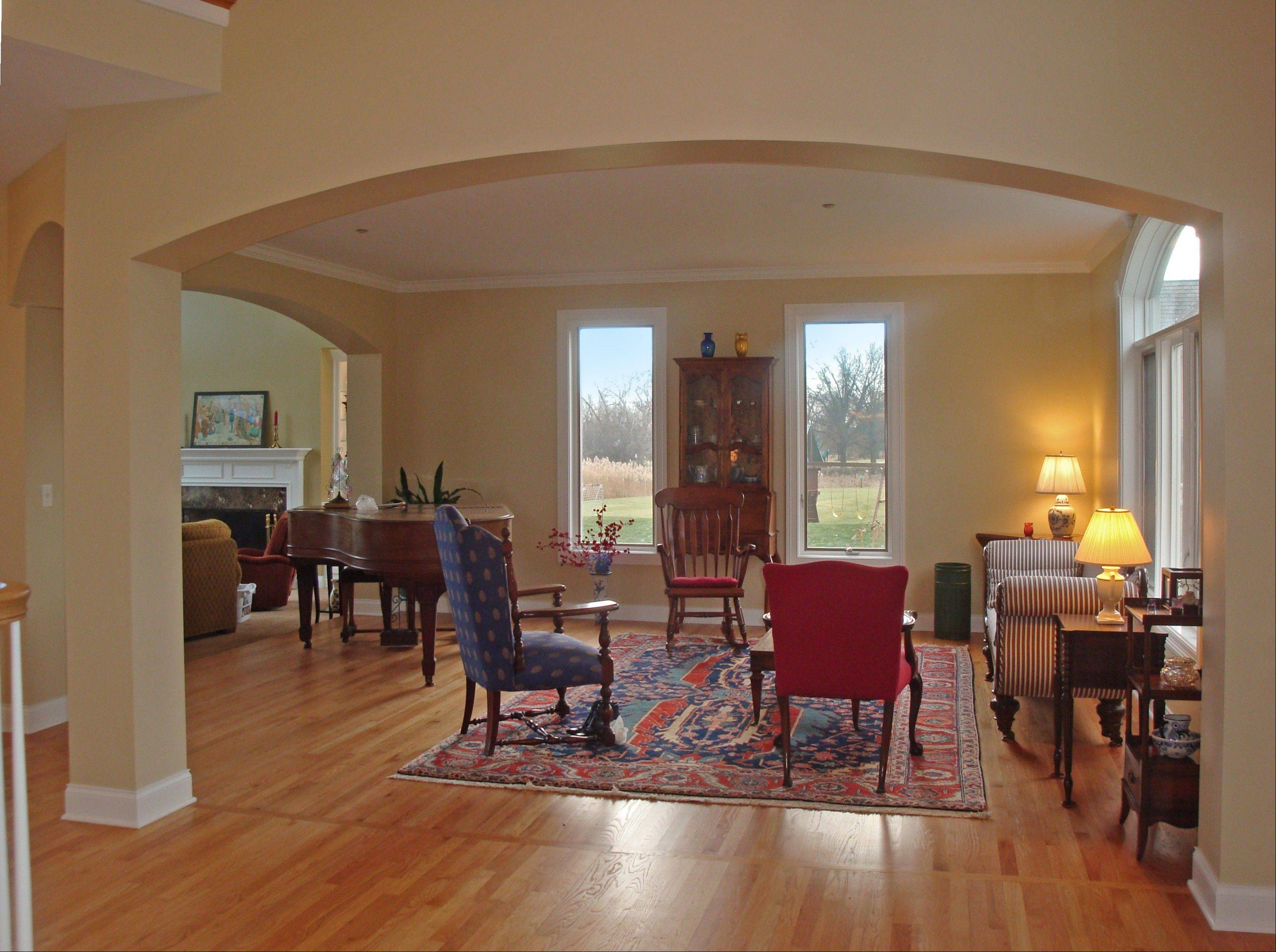 The main level features a living room, dining room, kitchen and foyer, all with hardwood floors.
