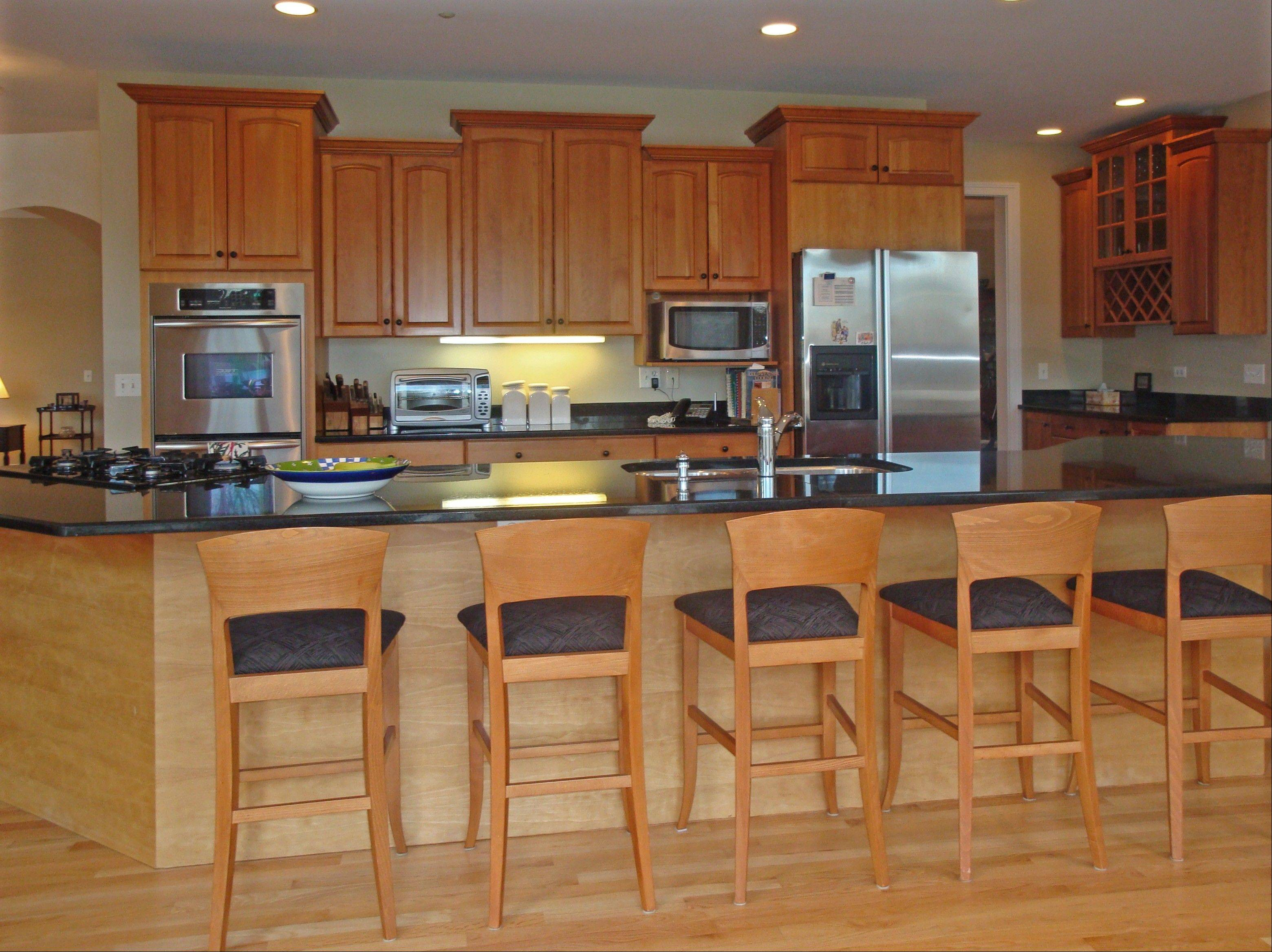 The house features a cherry kitchen with granite countertops.