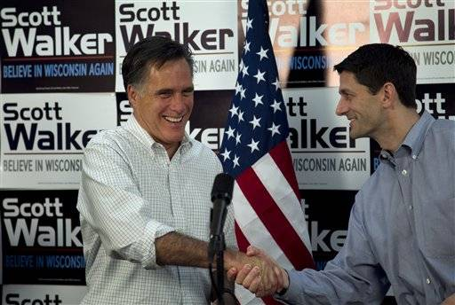 Republican presidential candidate, former Massachusetts Gov. Mitt Romney, left, shakes hands with U.S. Rep. Paul Ryan, R-Wis., Chairman of the House Budget Committee, right, before speaking with supporters of Wisconsin Republican Gov. Scott Walker at a phone bank during a campaign stop in Fitchburg, Wis., in this March 31, 2012 file photo. Romney has picked Wisconsin congressman Paul Ryan to be his running mate, according to a Republican with knowledge of the development. The newly minted GOP ticket will appear together Saturday in Norfolk, Va., at the start of a four-state bus tour to introduce the GOP ticket to the nation.