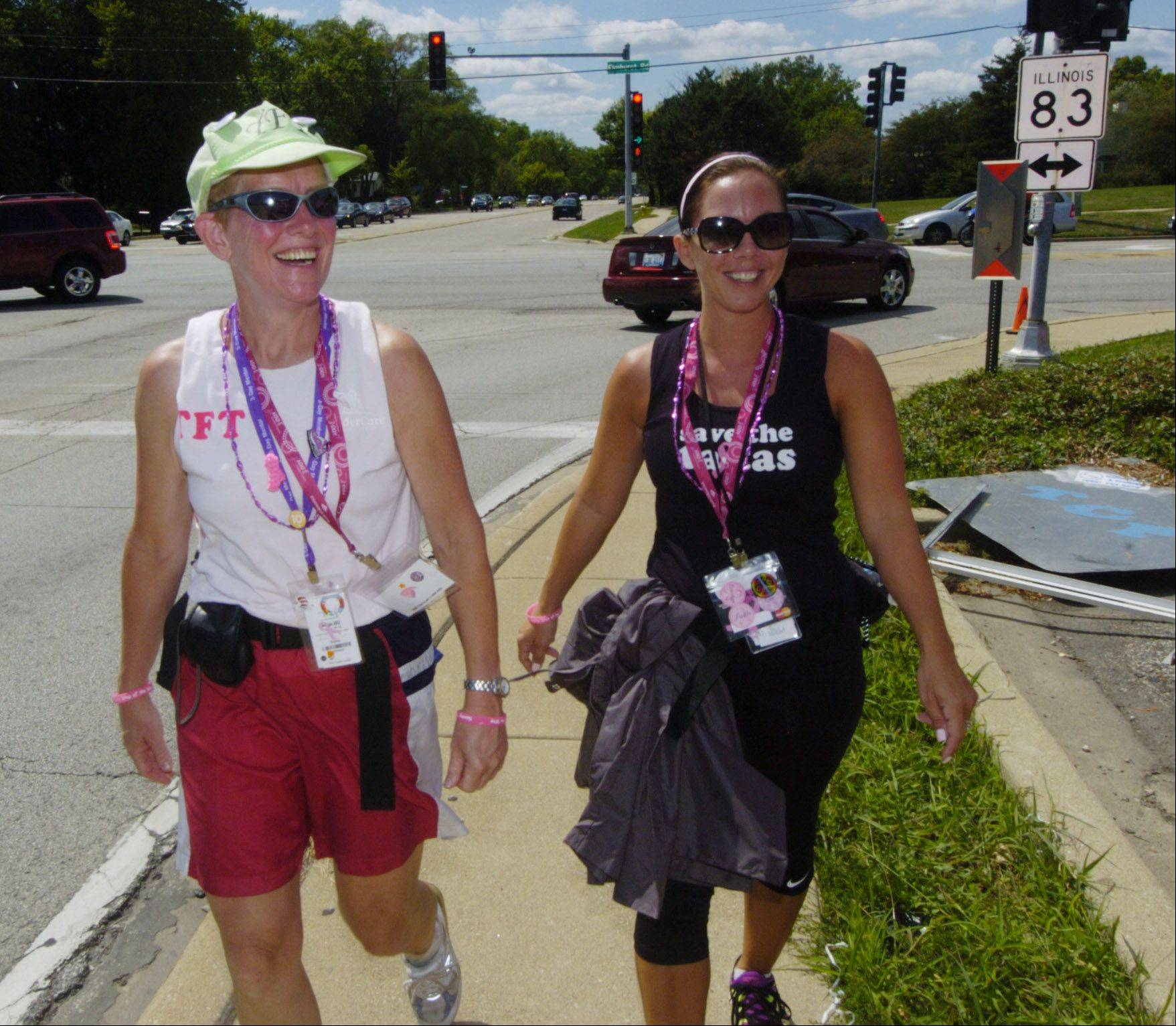 Doris Lovern, left, of Arlington Heights and Lindsay Mochan of Crystal Lake participate in the Susan G. Komen Chicago 3-Day, a 60-mile walk that passed through Mount Prospect on Saturday.