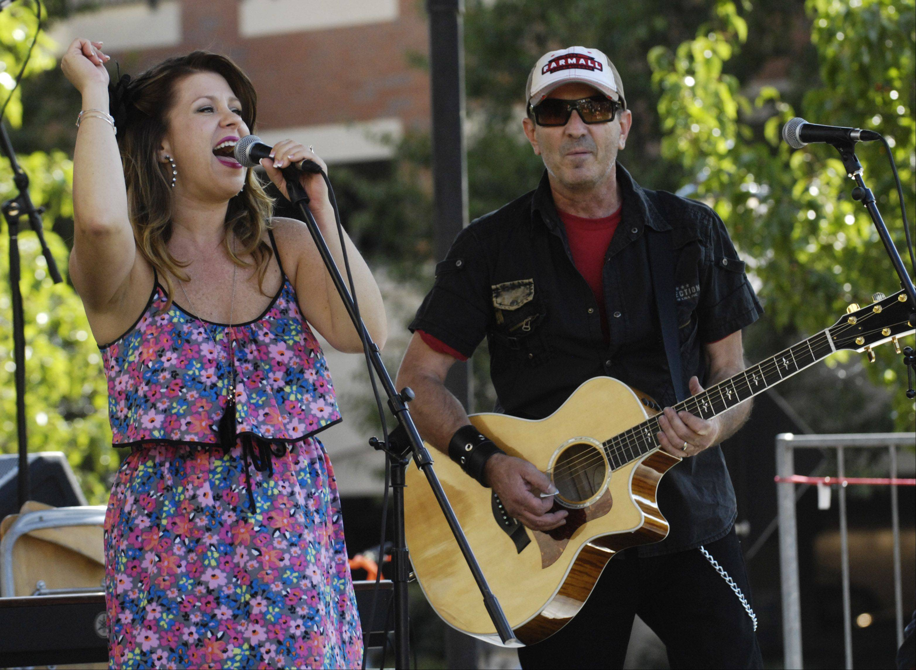 """Faith and Whisky"" with singer Camille Eiseman and guitarist/singer Terry Tank, both of Crystal Lake, performs during the Suburban Chicago's Got Talent finals Saturday at the Mane Event in downtown Arlington Heights."