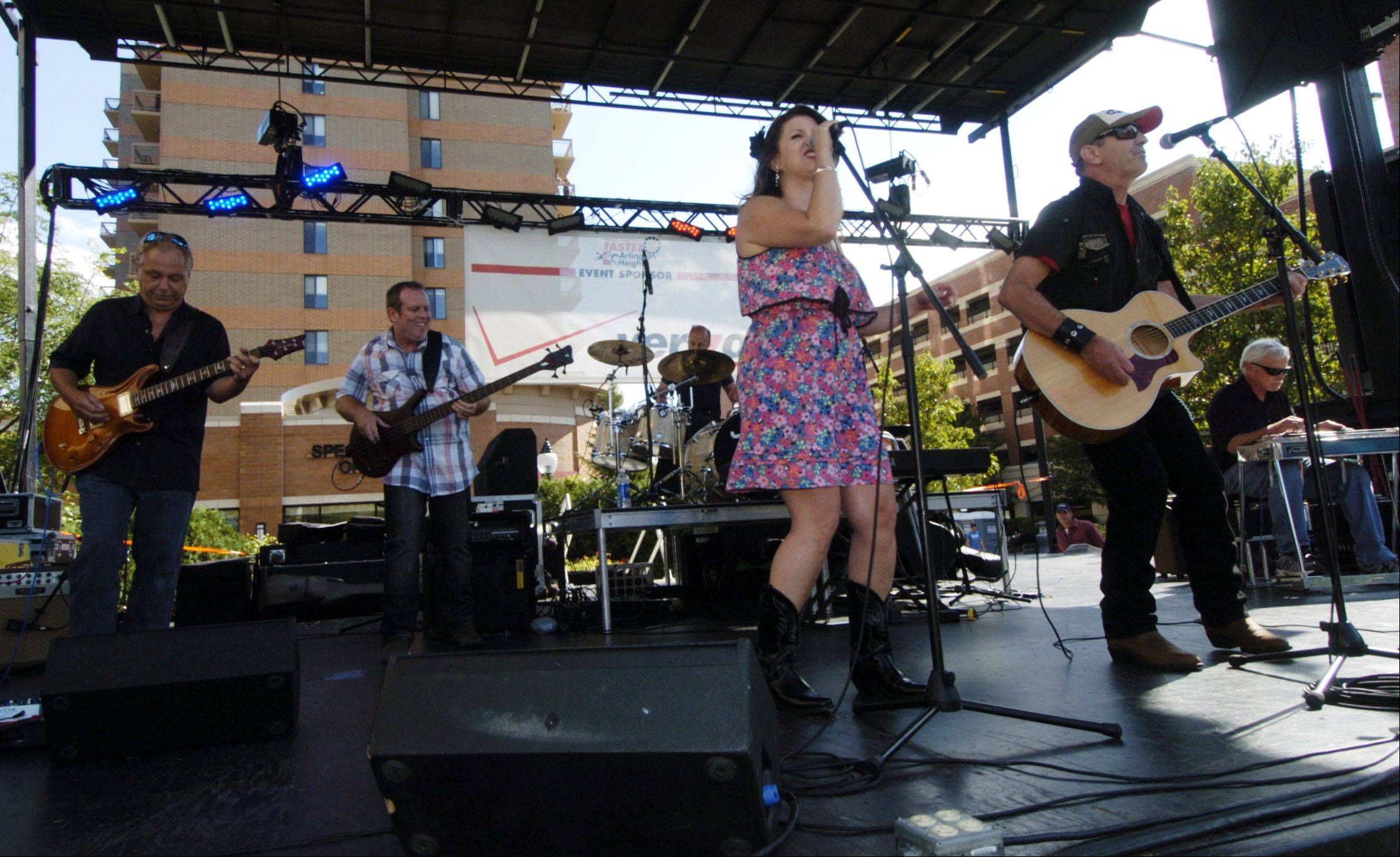 """Faith and Whisky"" with singer Camille Eiseman and guitarist/singer Terry Tank, who are both from Crystal Lake, performs during the Suburban Chicago's Got Talent finals Saturday at the Mane Event in downtown Arlington Heights."