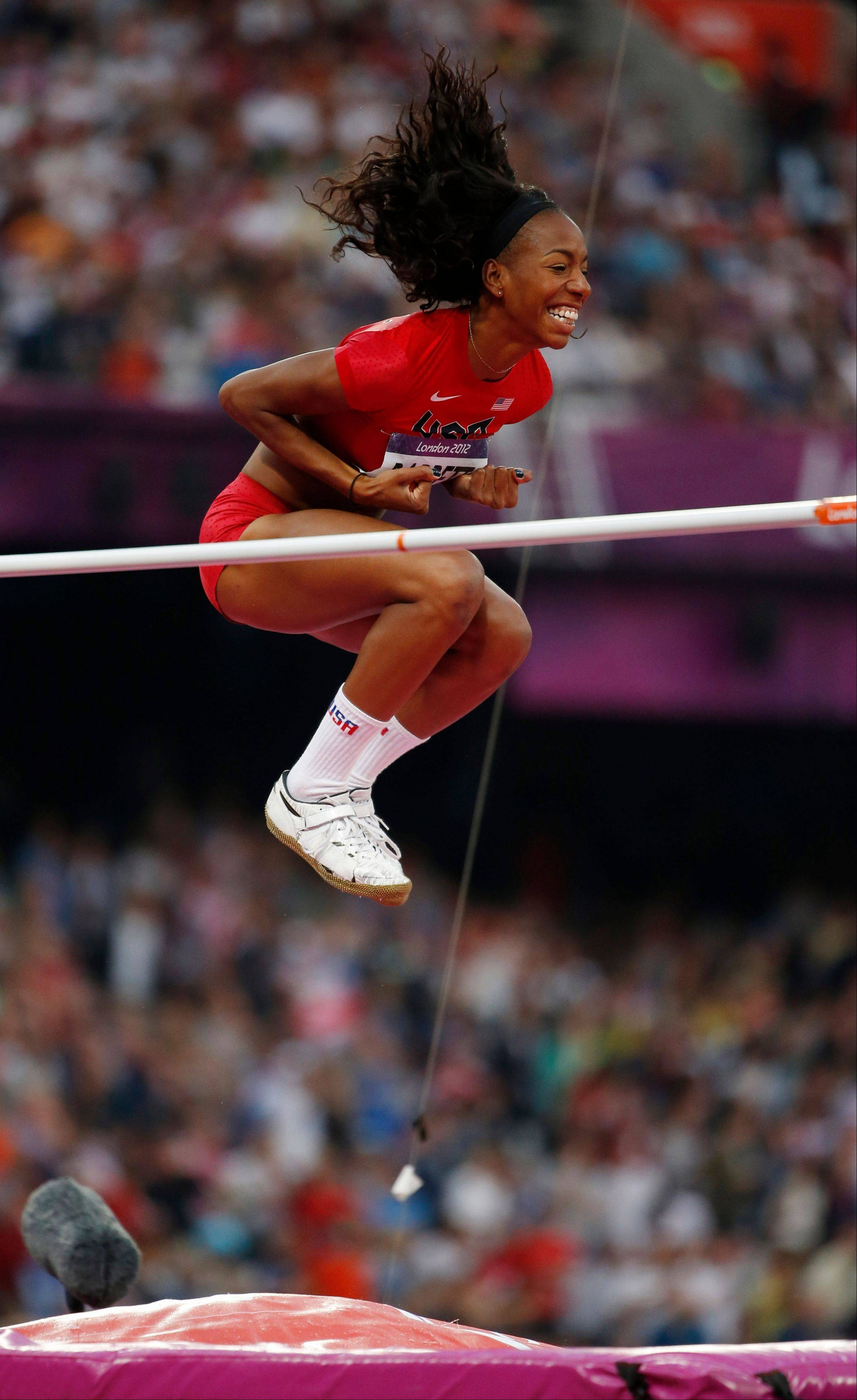United States' Brigetta Barrett reacts as she clears the bar in the women's high jump final during the athletics in the Olympic Stadium at the 2012 Summer Olympics, London, Saturday, Aug. 11, 2012.
