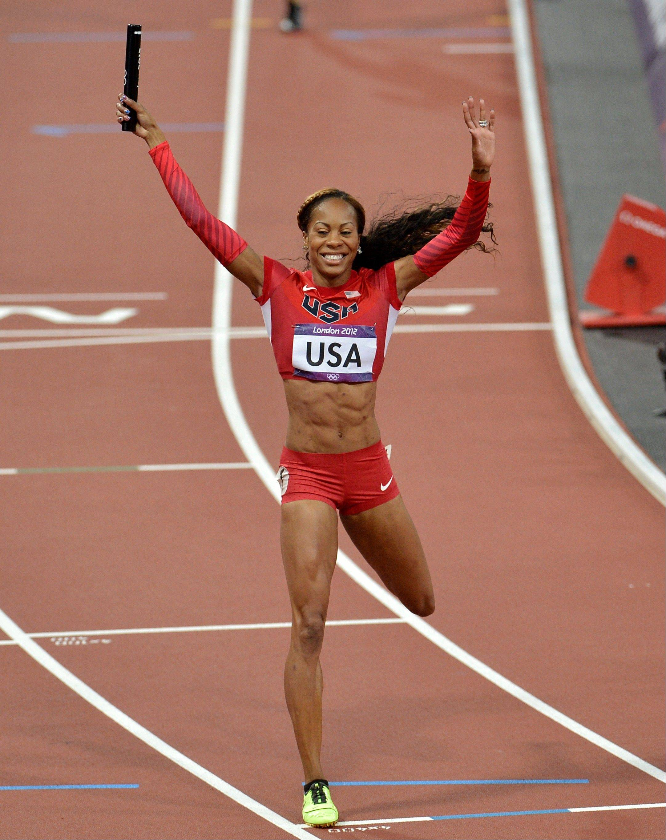United States' Sanya Richards-Ross celebrates asfter crossing the finish line to win the women's 4 x 400-meter relay final during the athletics in the Olympic Stadium at the 2012 Summer Olympics, London, Saturday, Aug. 11, 2012.