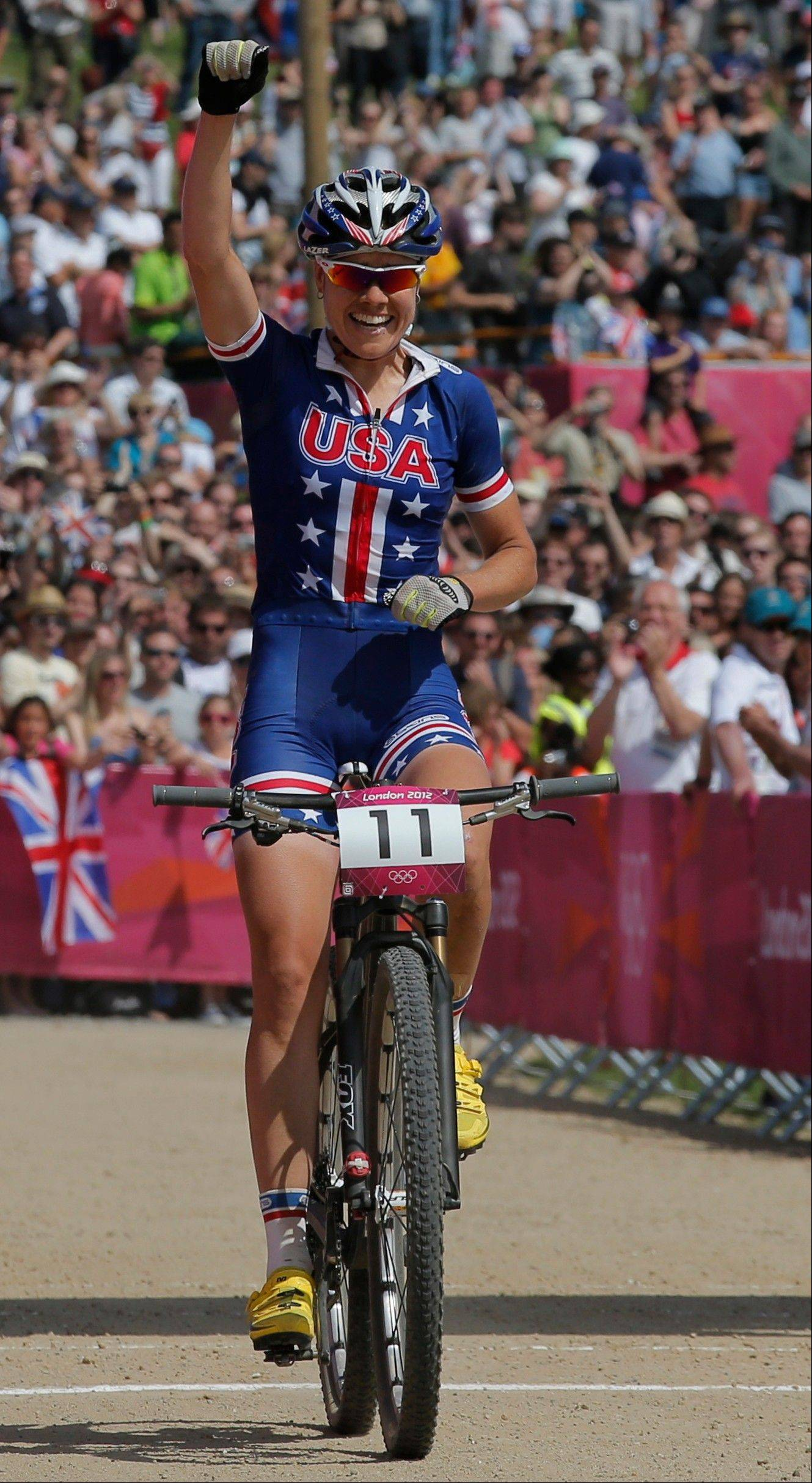 United States' Georgia Gould (11) crosses the finish line to win the bronze medal in the Mountain Bike Cycling women's race, at the 2012 Summer Olympics, Saturday, Aug. 11, 2012, at Hadleigh Farm, in Essex, England.