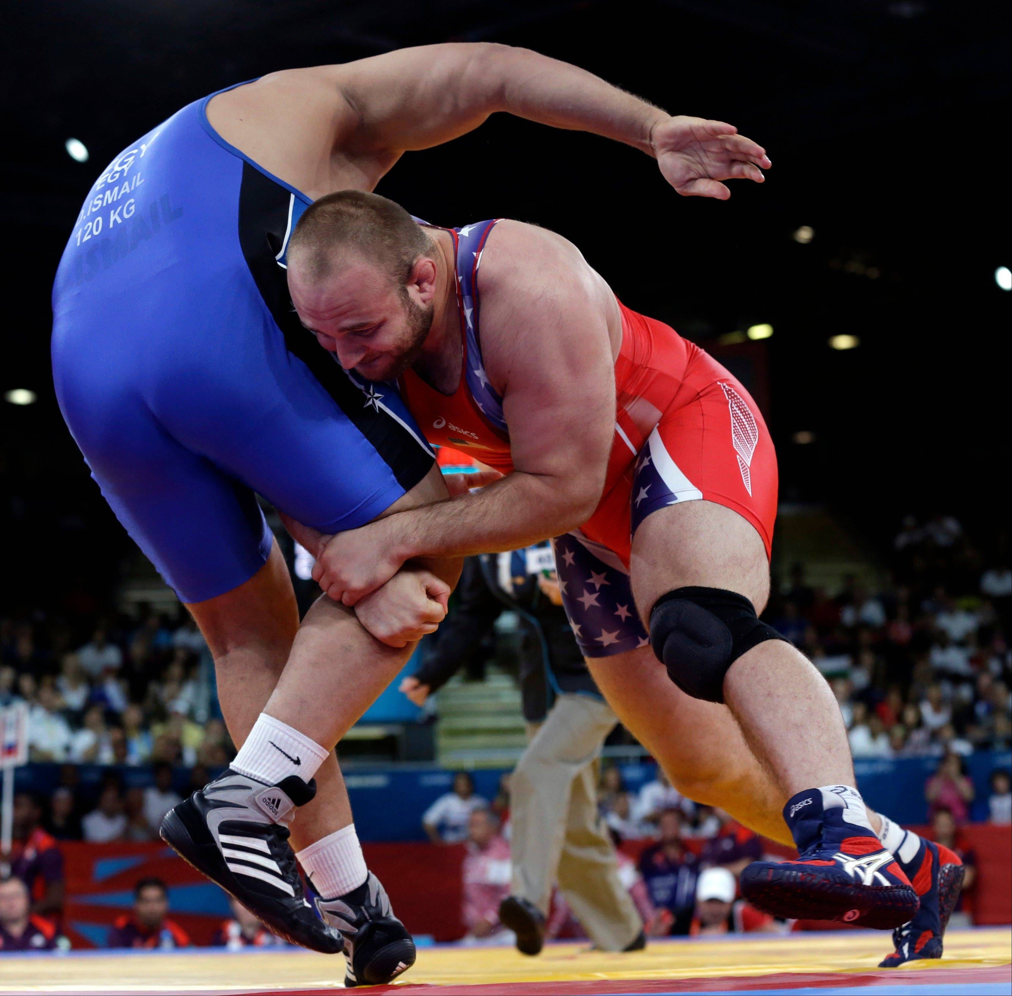 Tervel Ivaylov Dlagnev of the United States competes against Eldesoky Shaban of Egypt (in blue) during the men's 120-kg freestyle wrestling competition at the 2012 Summer Olympics, Saturday, Aug. 11, 2012, in London.