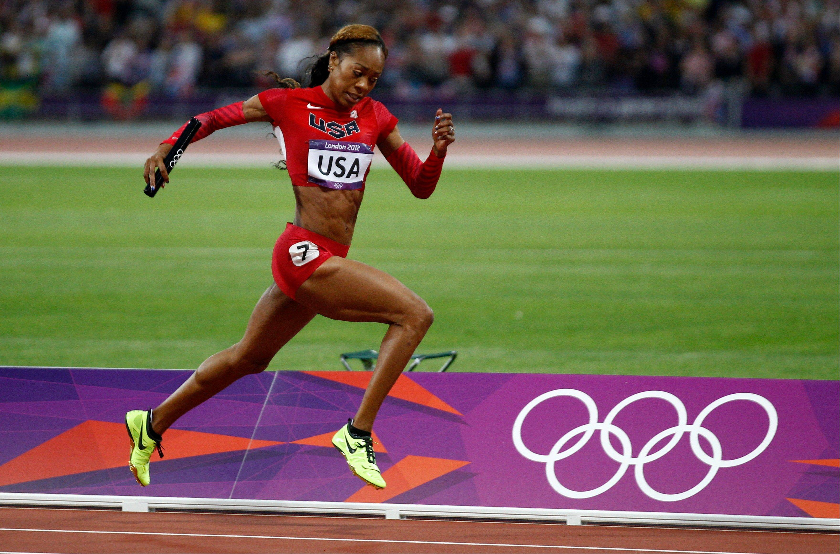 United States' Sanya Richards-Ross leads to win in the women's 4 x 400-meter relay during the athletics in the Olympic Park during the 2012 Summer Olympics, Saturday, Aug. 11, 2012, in London.