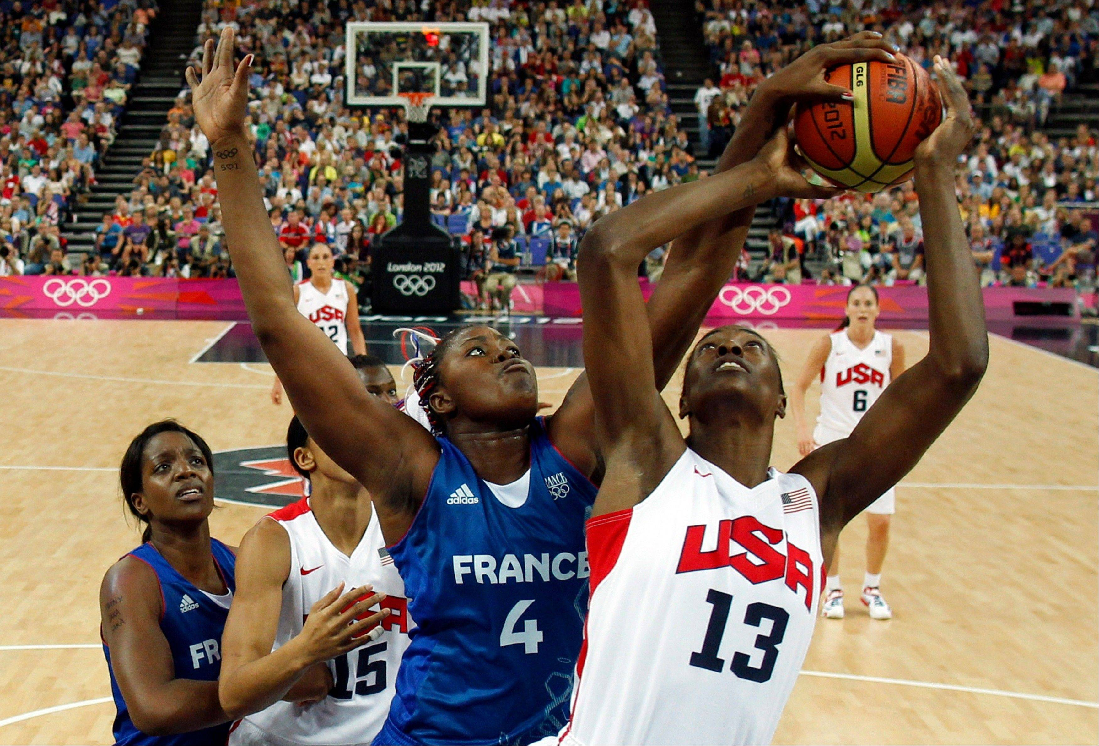 France's Isabelle Yacoubou (4) blocks the shot of Sylvia Fowles (13) of the United States during their women's gold medal basketball game at the 2012 Summer Olympics on Saturday, Aug. 11, 2012, in London.