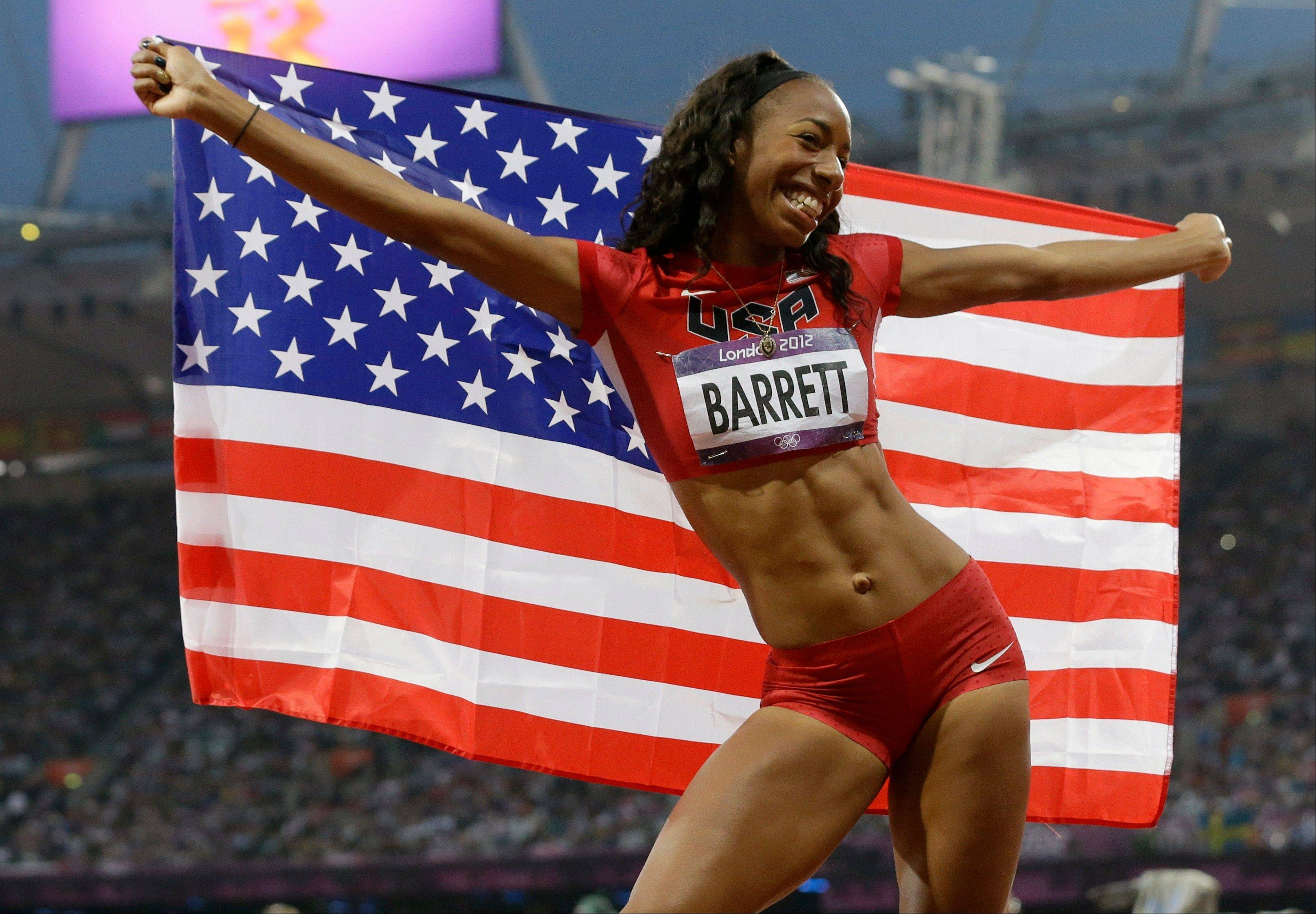 United States' Brigetta Barrett poses with her national flag after her second place win in the women's high jump during the athletics in the Olympic Stadium at the 2012 Summer Olympics, London, Saturday, Aug. 11, 2012.