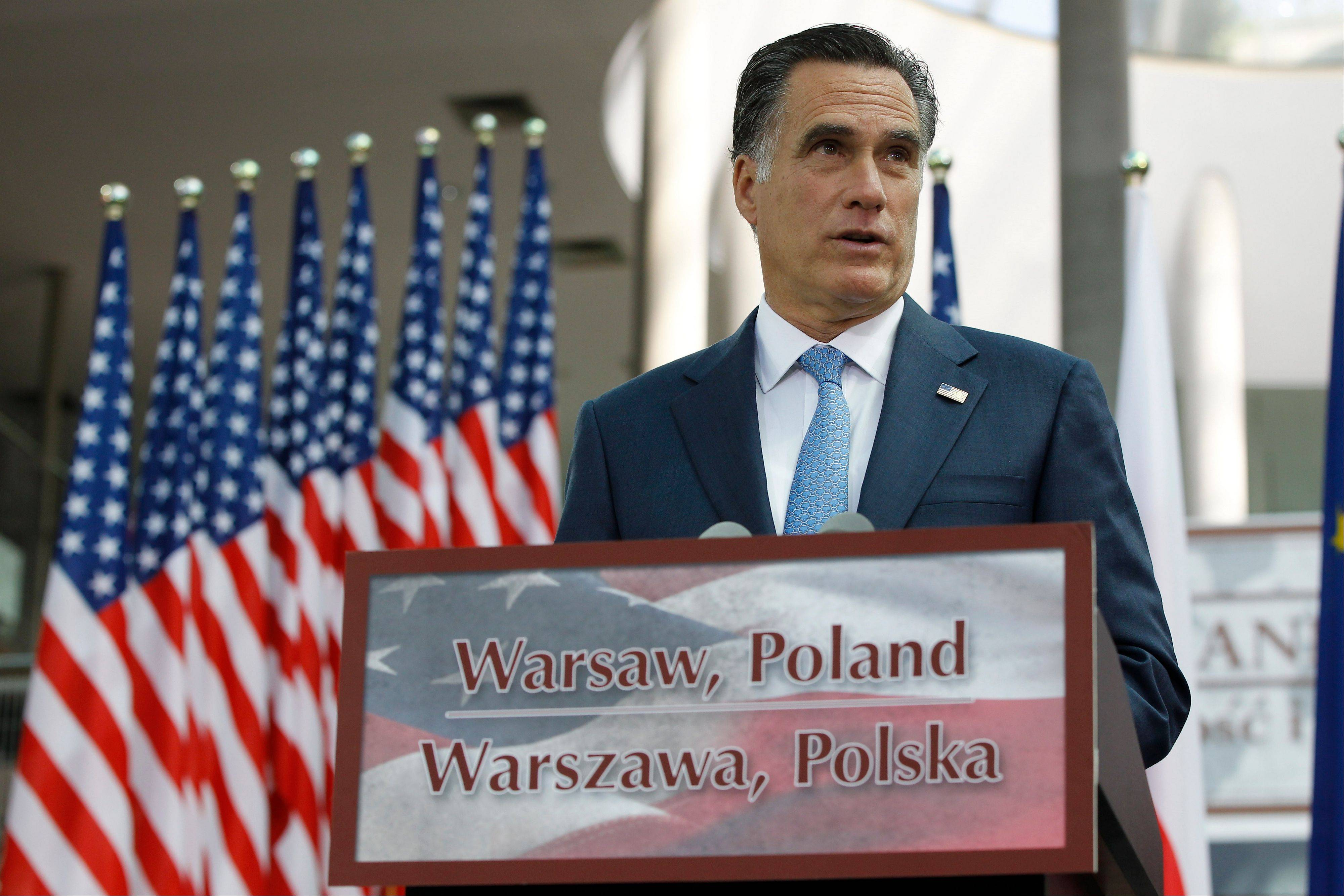 "Republican presidential candidate and former Massachusetts Gov. Mitt Romney speaks at the University of Warsaw Library in Warsaw, Poland, on July 31. In a poll of 1,000 registered voters, Romney's numbers dropped in July, possibly because of a botched ""charm offensive"" at the Olympics and other European countries."
