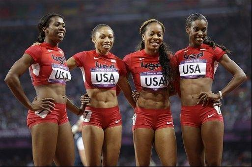 United States' women's 4 X 400-meter relay team from left, Francena McCorory, Allyson Felix, Sanya Richards-Ross and Deedee Trotter celebrate after winning the gold medal during the athletics in the Olympic Stadium at the 2012 Summer Olympics, London, Saturday, Aug. 11, 2012.