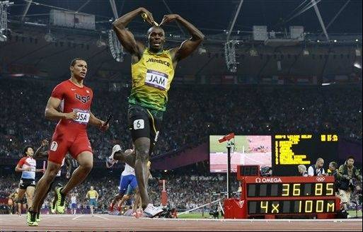 Jamaica's Usain Bolt celebrates his win in the men's 4 x 100-meter relay final during the athletics in the Olympic Stadium at the 2012 Summer Olympics, London, Saturday, Aug. 11, 2012. Jamaica set a new world record with a time of 36.84 seconds.