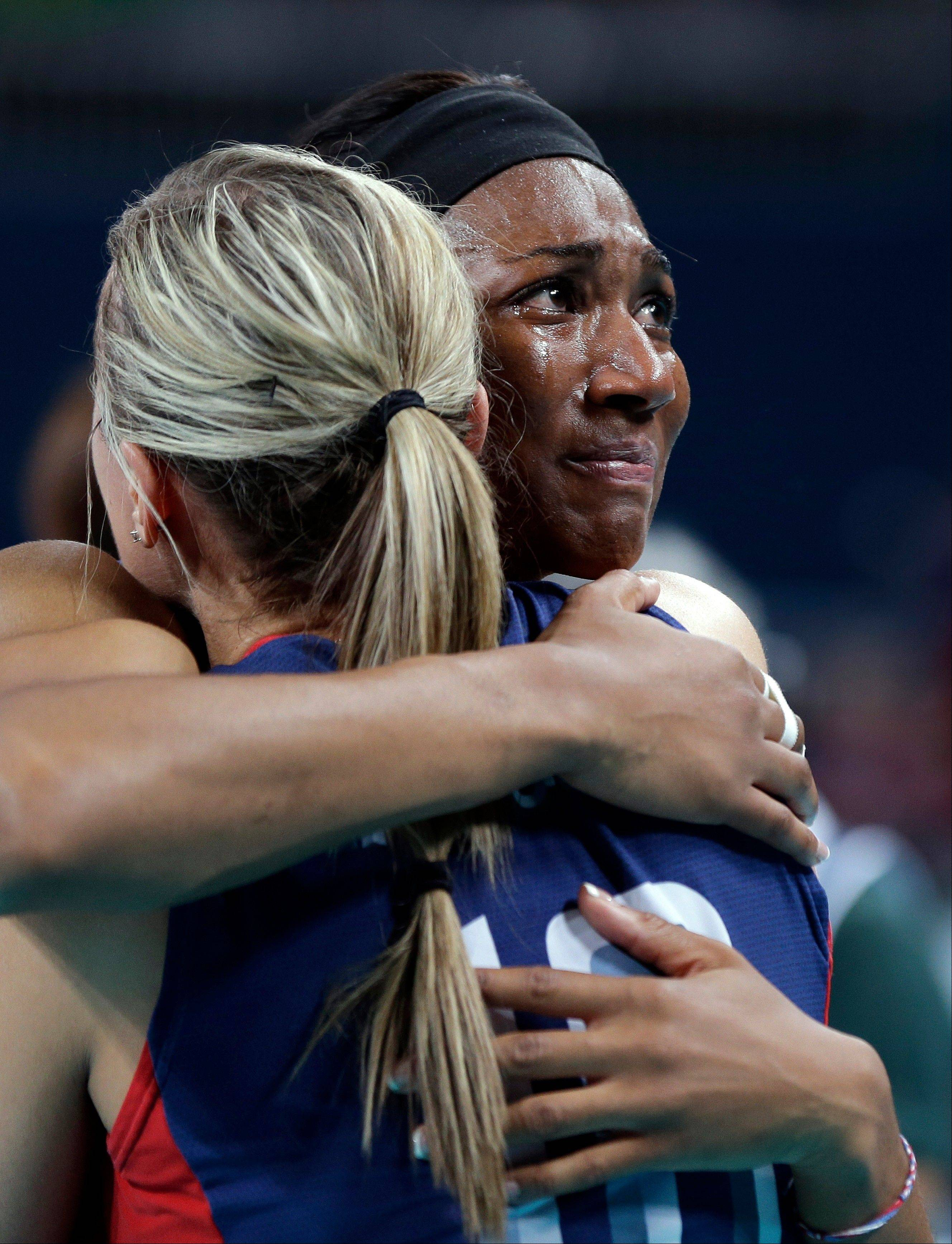 USA's Foluke Akinradewo (16, right) cries as she hugs teammate Jordan Larson (10) after losing to Brazil 3-1 during a women's volleyball gold medal match at the 2012 Summer Olympics Saturday, Aug. 11, 2012, in London.