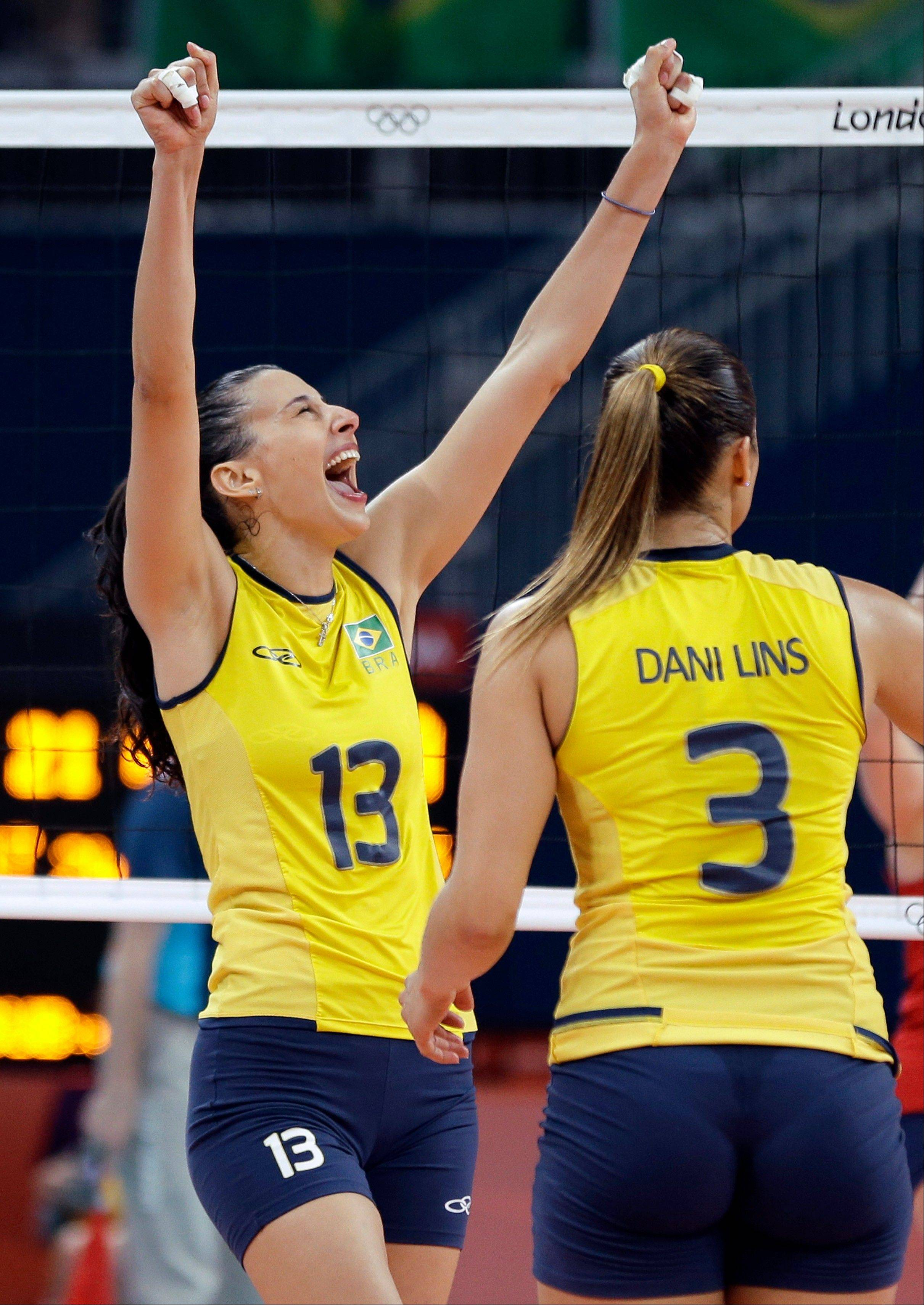 Brazil's Sheilla Castro (13) and Danielle Lins (3) react to a point against the USA during a women's volleyball gold medal match at the 2012 Summer Olympics Saturday, Aug. 11, 2012, in London.