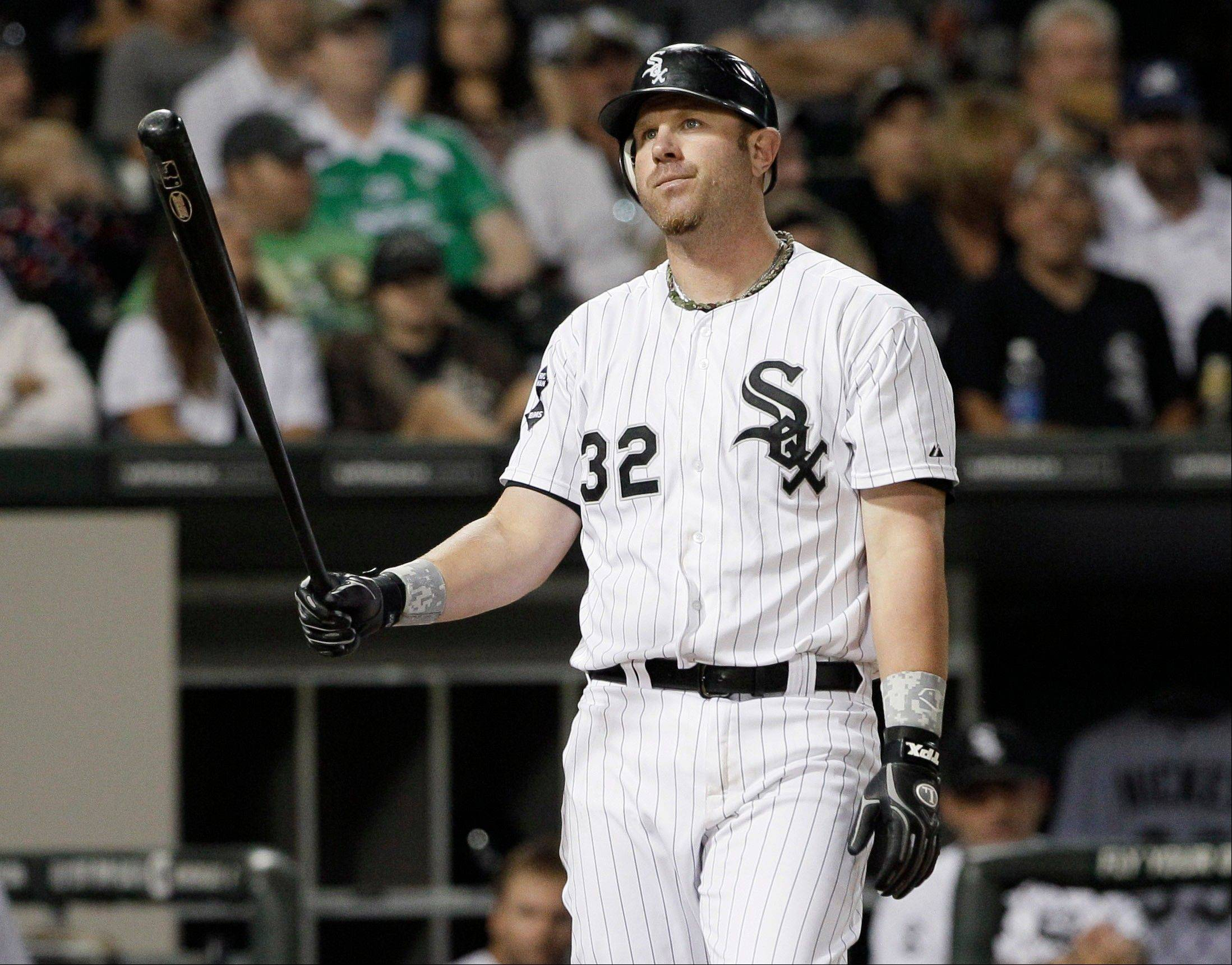 Adam Dunn reacts after striking out during the seventh inning of Saturday night's loss to the Athletics at U.S. Cellular Field.