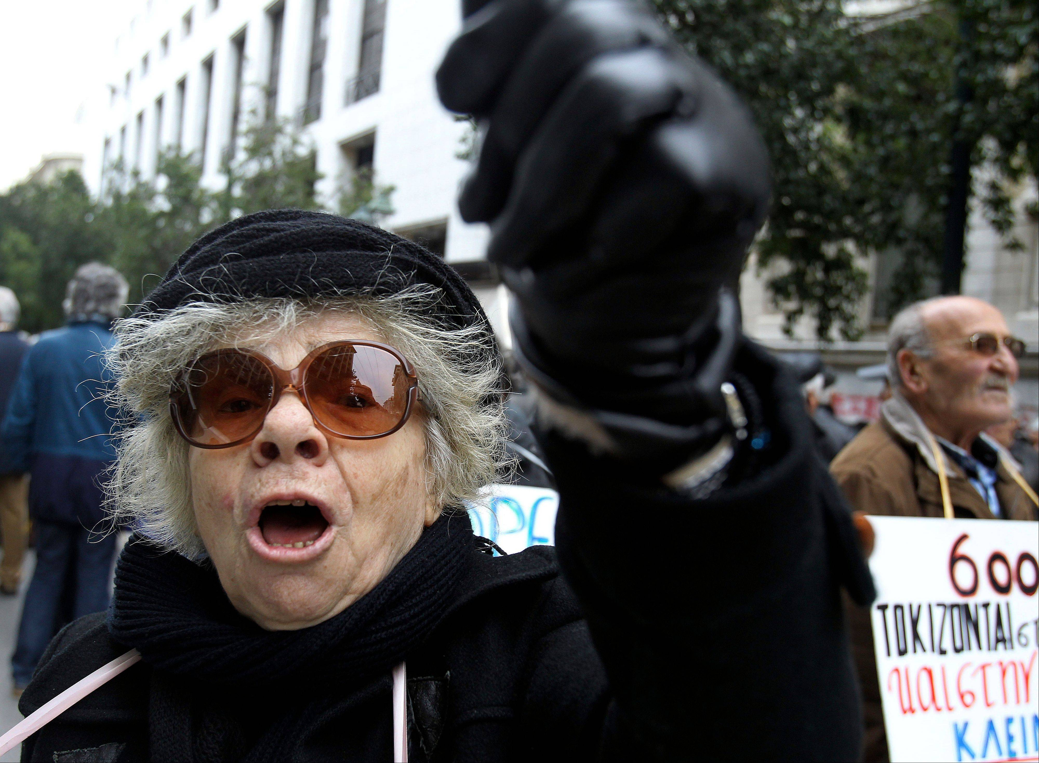 A pensioner shouts slogans during a protest against the Greek government's planned pension cut, outside Labor Ministry in Athens. Resentful stereotypes are increasingly jumping from pub conversation and tabloid pages into the mainstream political discourse in Europe.