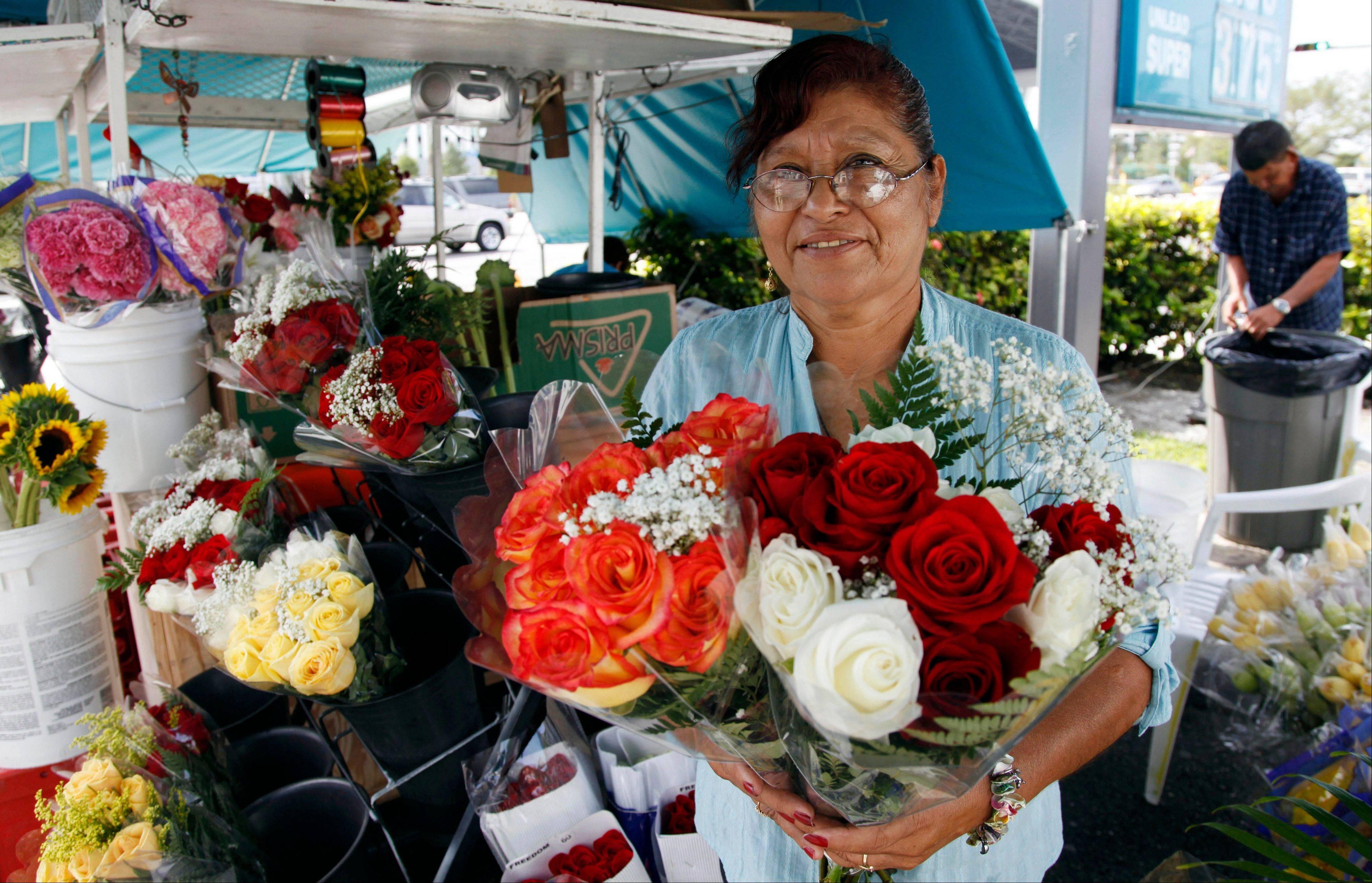 Margarita Briones holds bouquets of flowers at her flower shop Margarita Flowers, in Miami. In cities like Miami, New York, Houston and Los Angeles, a small but growing group of mostly immigrant and minority entrepreneurs are turning to microfinancing.