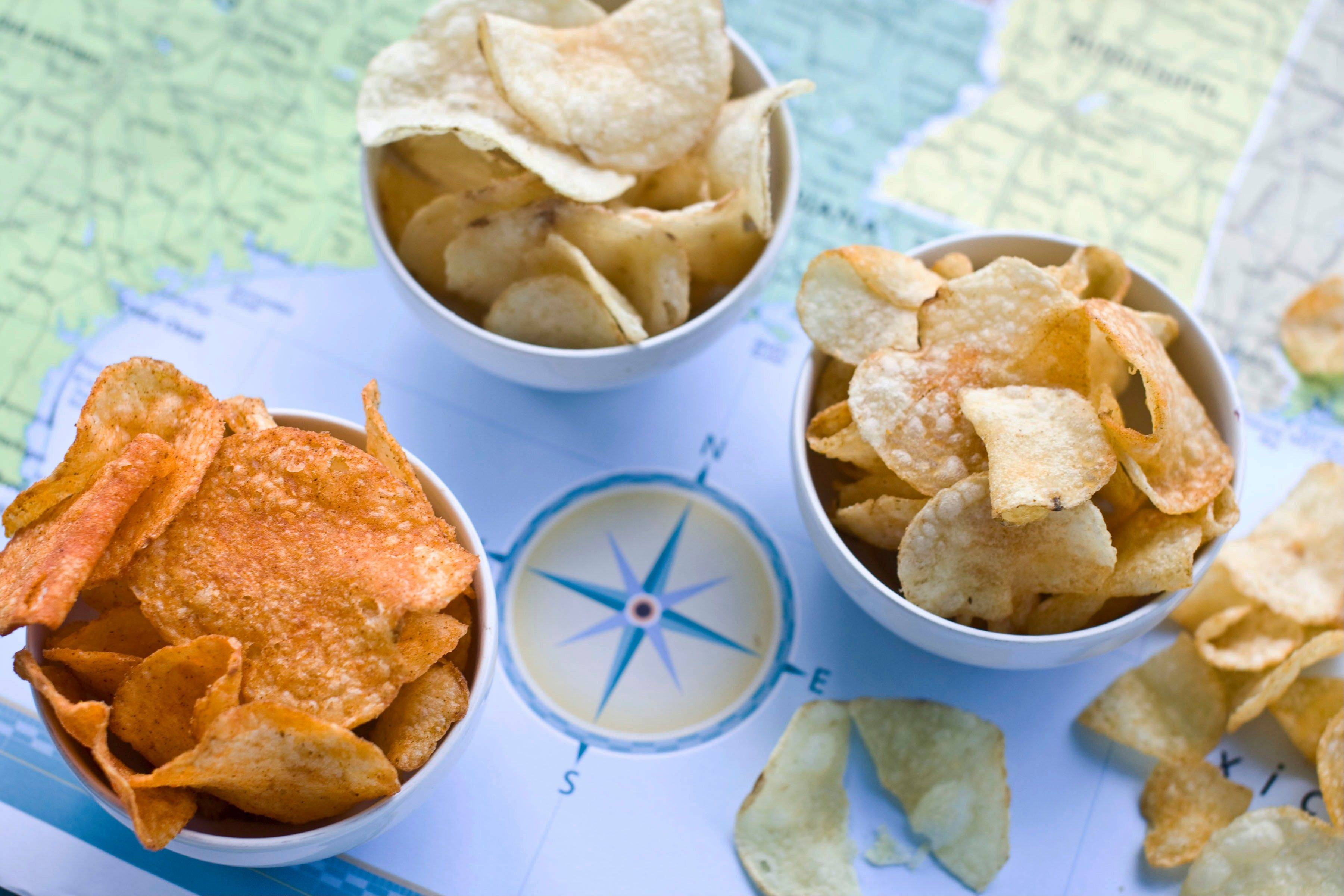 Poore Brother's Habanero, from left, Route 11 Chips Chesapeake Crab, and Boulder Canyons Red Wine Vinegar, potato chips are shown in Concord, N.H.