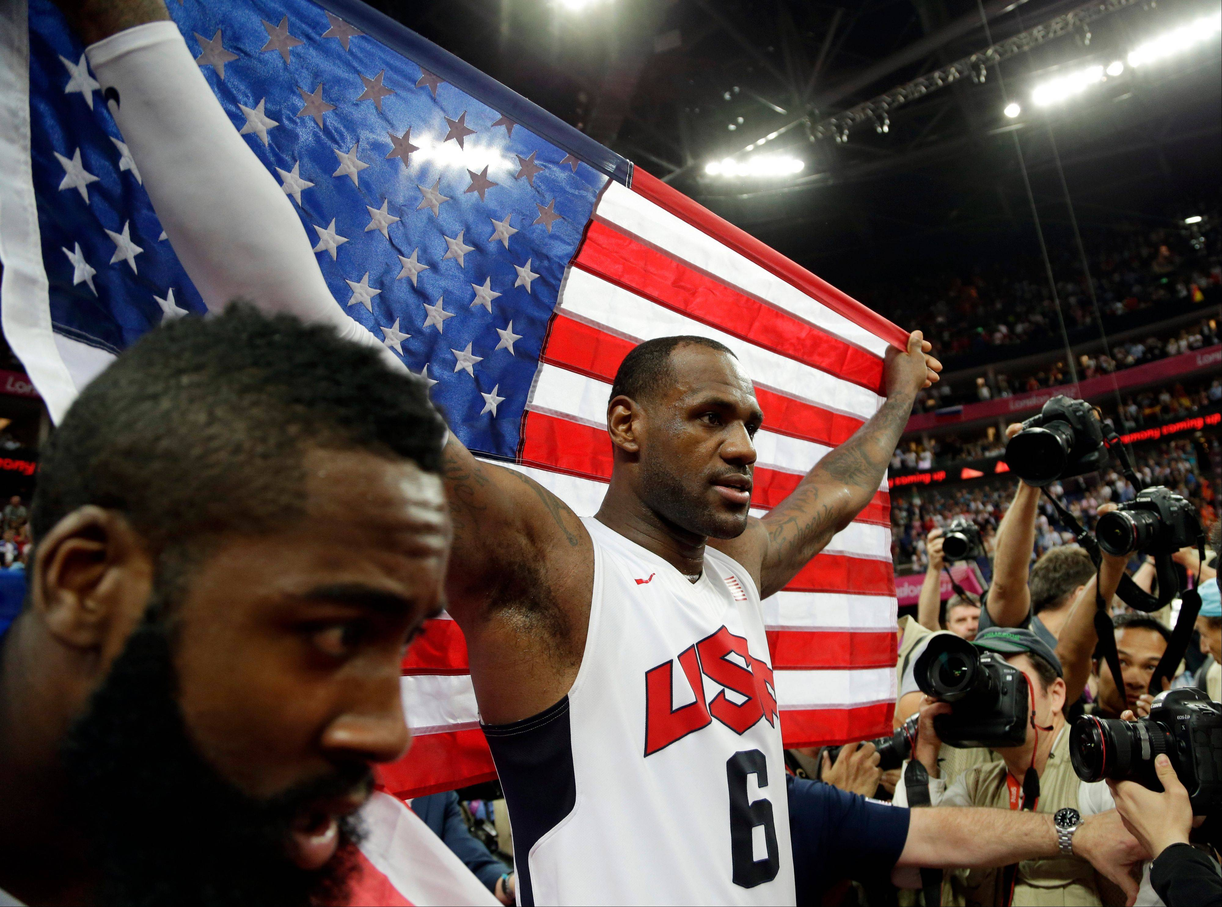 United States' LeBron James celebrates after the men's gold medal basketball game at the 2012 Summer Olympics, Sunday, Aug. 12, 2012, in London. USA won 107-100.