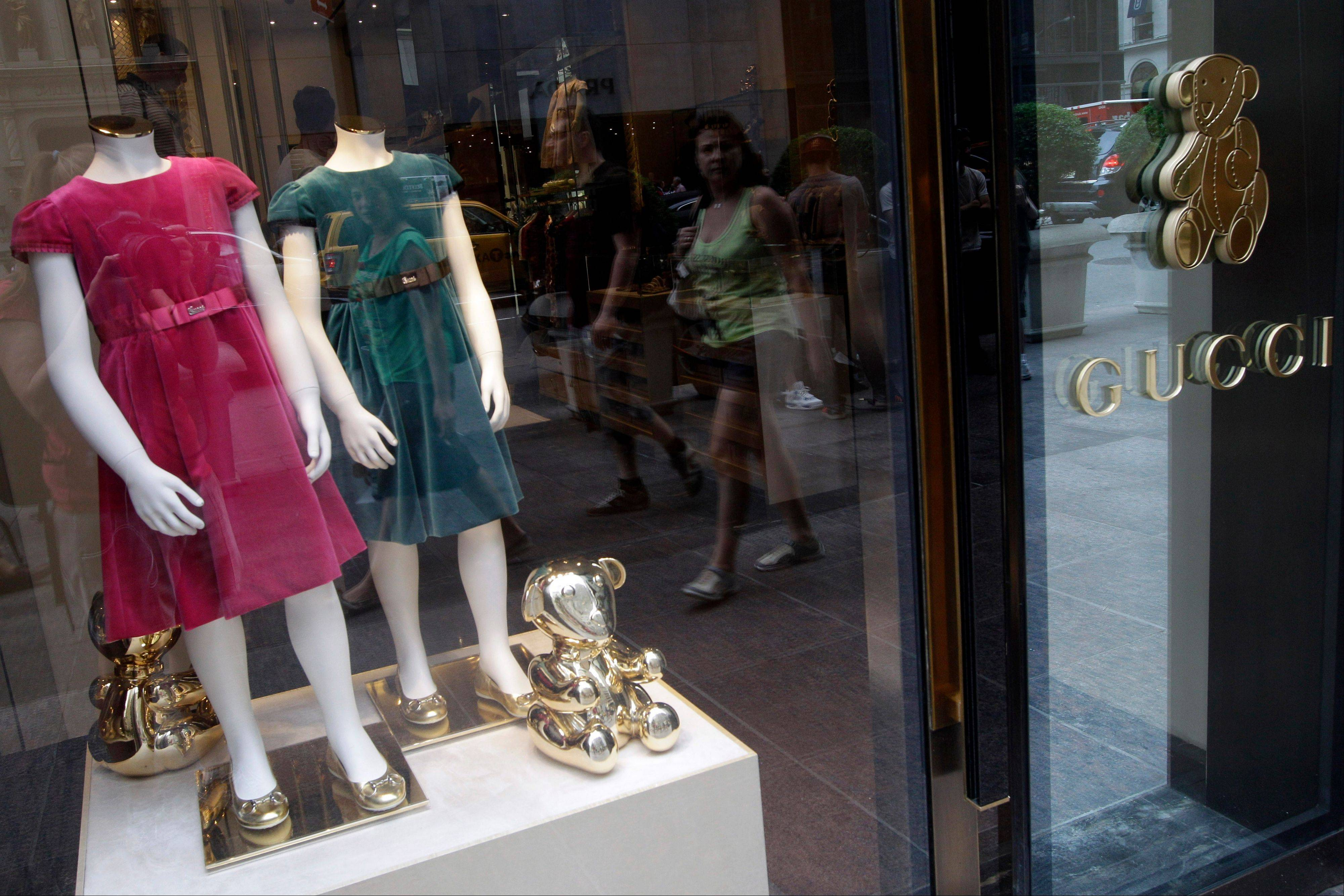 Girls dresses appear on display at the Gucci children's boutique on Fifth Avenue in New York. Gucci's two-level children's boutique, next door to its adult flagship, may have brass teddy bears on the walls and plush child-sized furniture, but the prices for the miniature looks are hardly child's play.