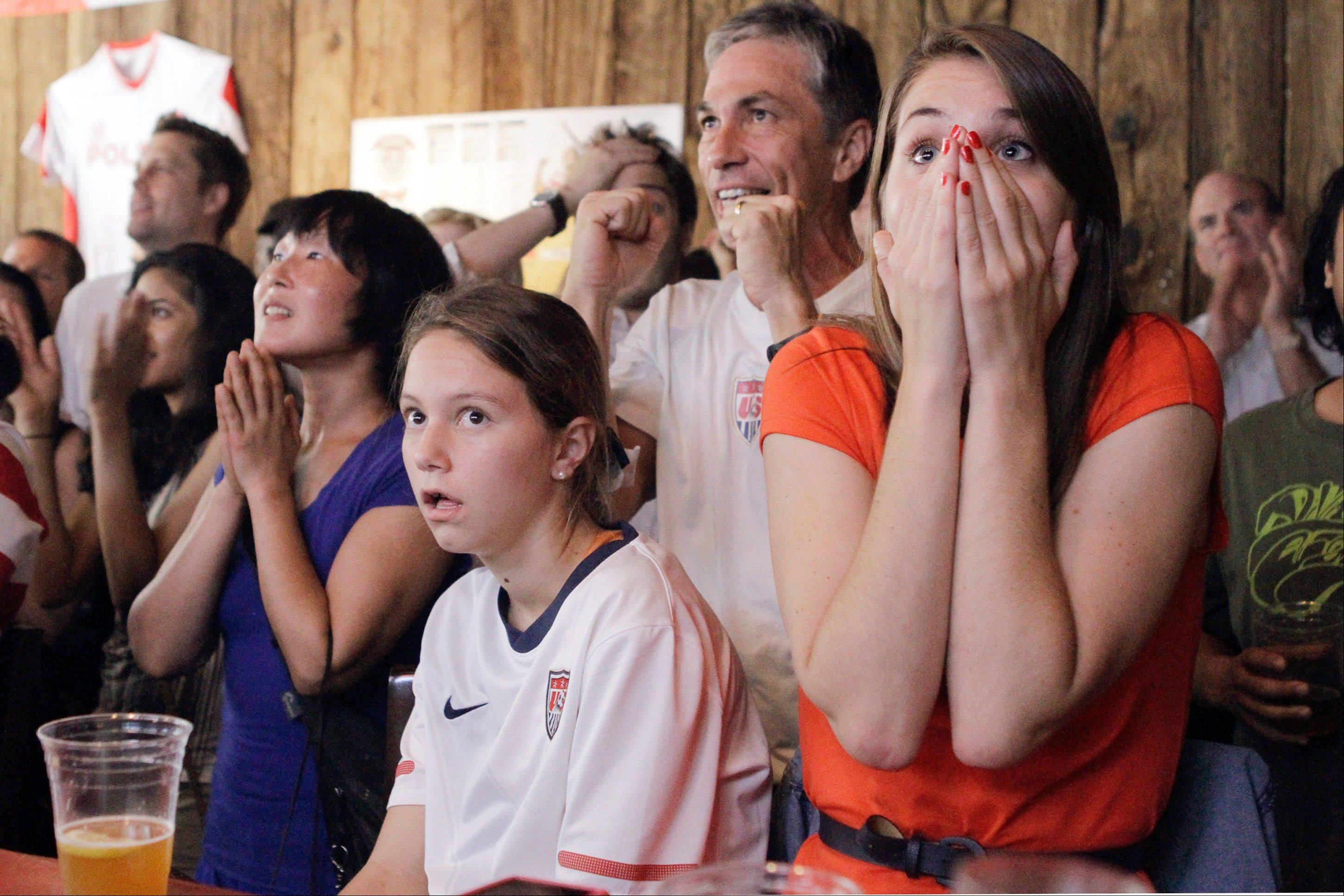 Viewers react as they watch a television broadcast of the U.S. women's soccer team taking on Japan in the gold medal match at the 2012 London Summer Olympics Thursday, at Nevada Smiths bar in New York.