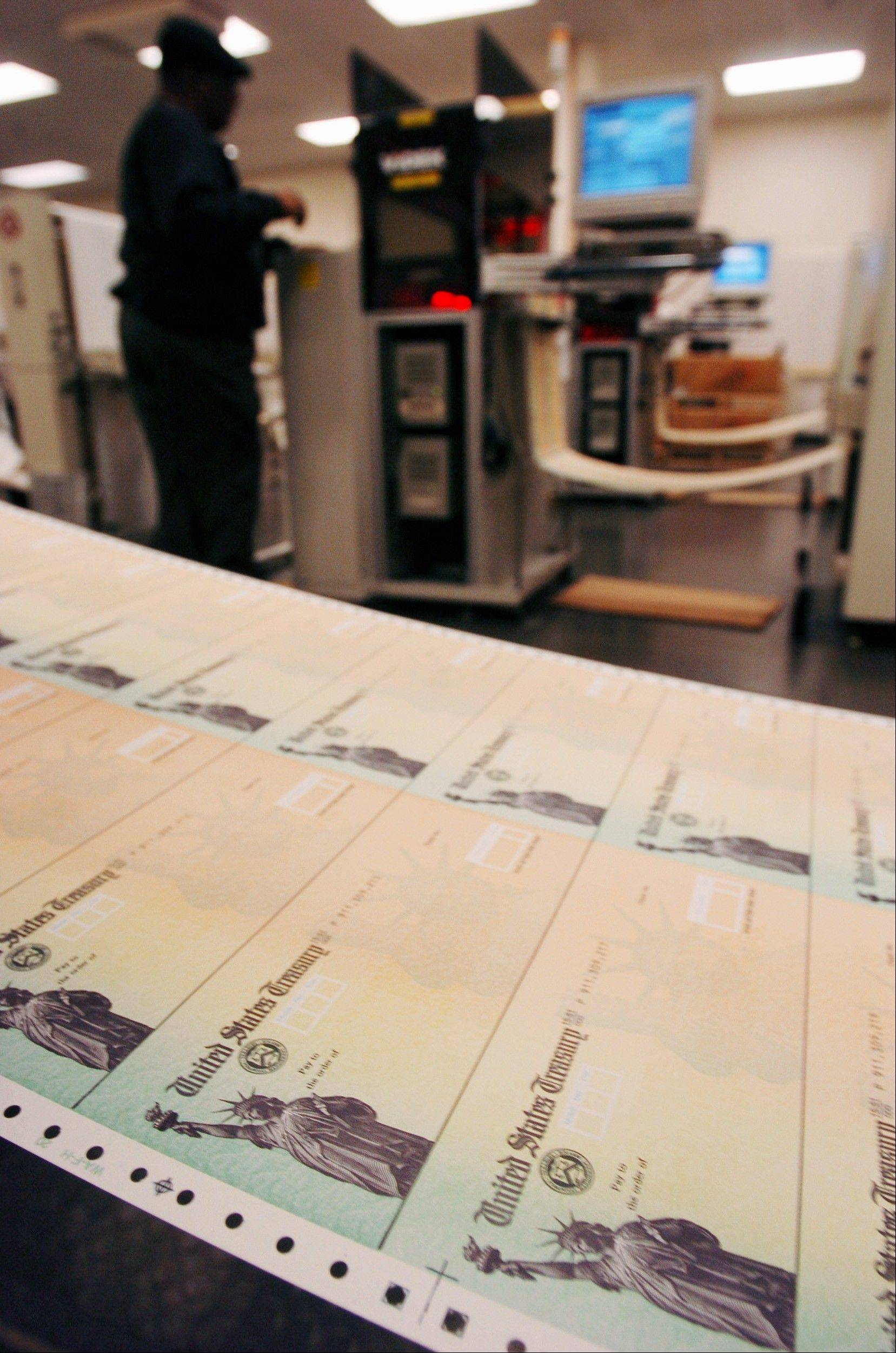 Rolls of blank Social Security checks run through printers and are processed at the U.S. Treasury's Financial Management Services facility in Philadelphia.