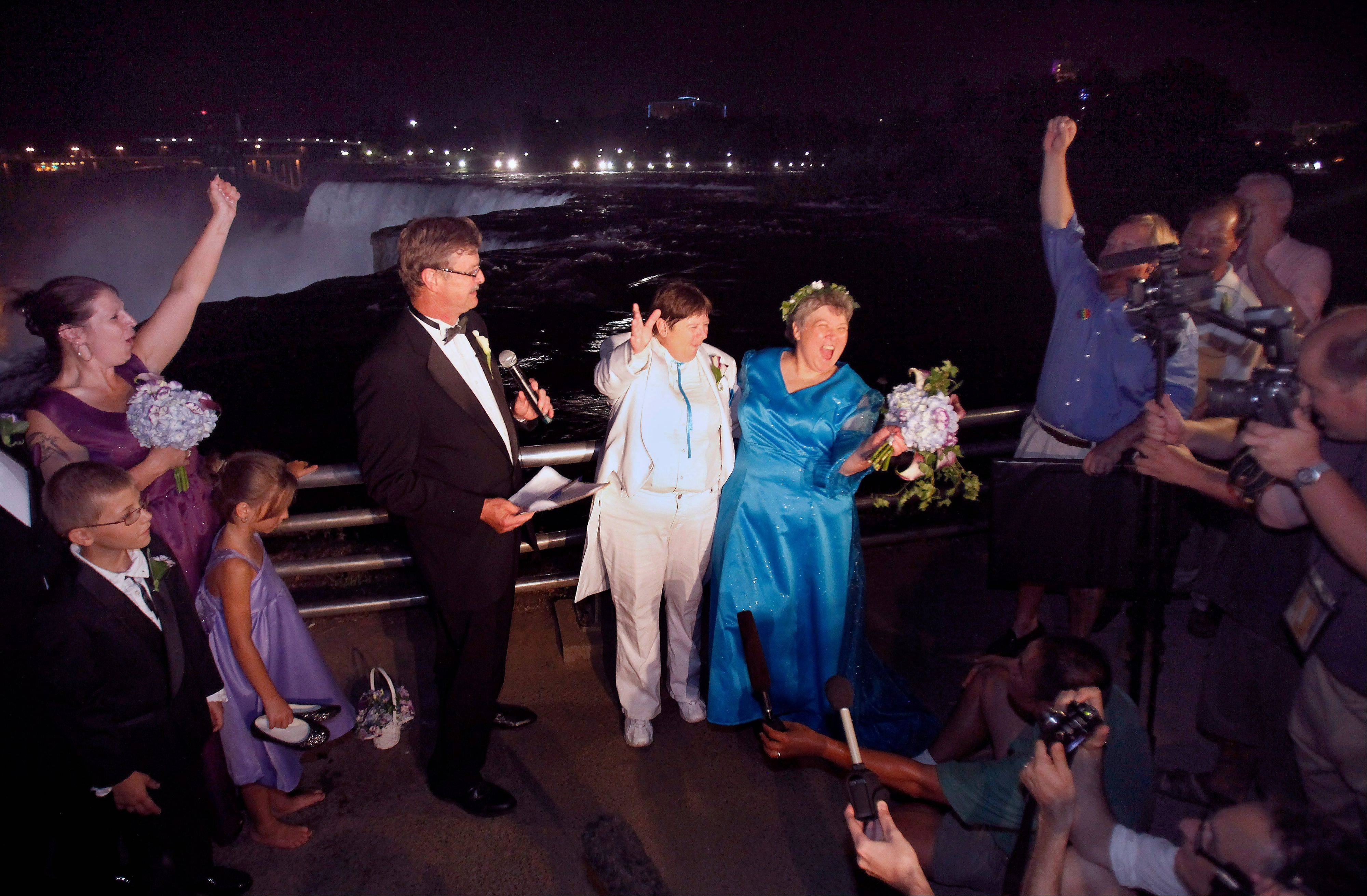 Kitty Lambert, right, and Cheryle Rudd celebrate their marriage in Niagara Falls, N.Y.