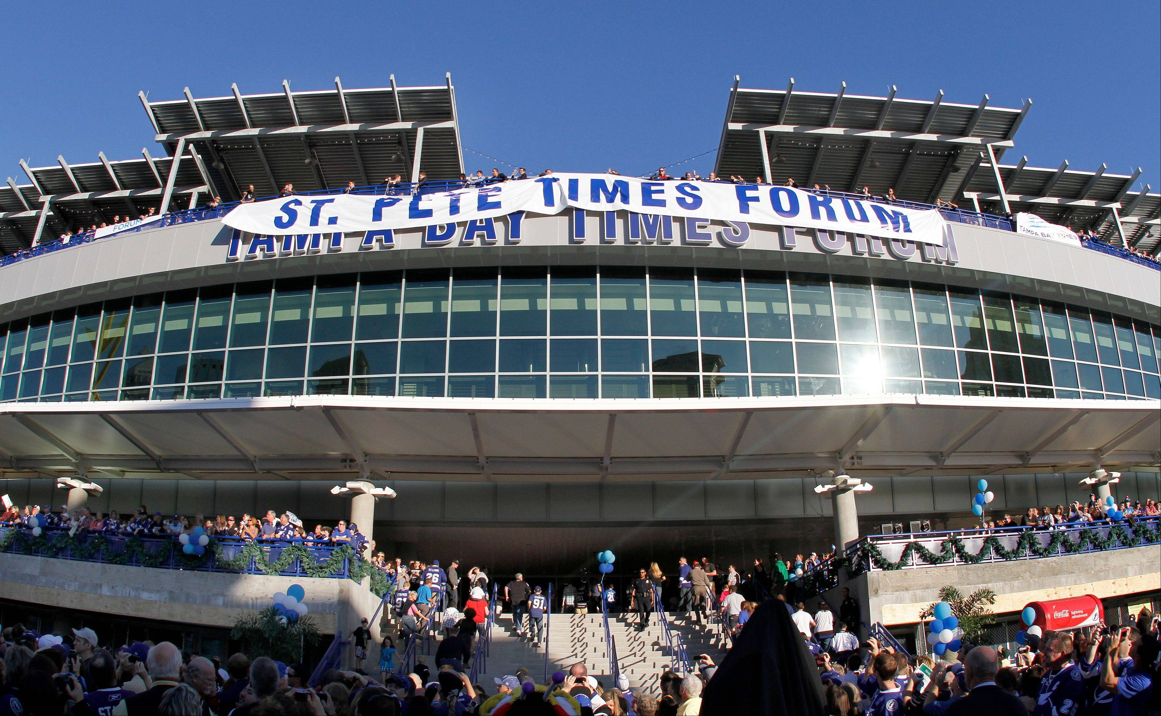 The St. Pete Times Forum unveils its new name, The Tampa Bay Times Forum, before the start of an NHL hockey game between the Tampa Bay Lightning and Carolina Hurricanes.