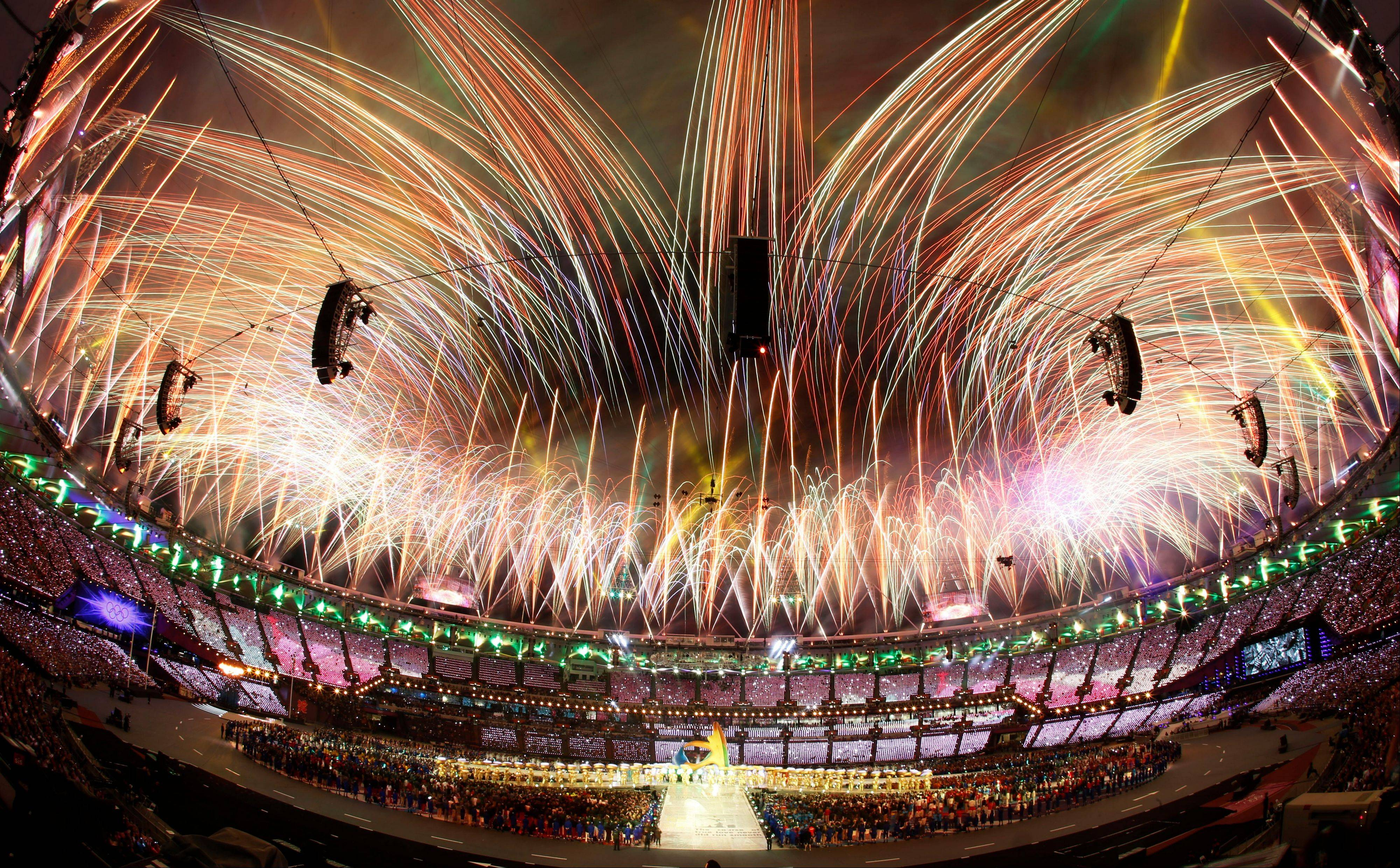 In this photo taken with a fisheye lens, pyrotechnics light up the sky above the Olympic Stadium during the Closing Ceremony at the 2012 Summer Olympics, Sunday, Aug. 12, 2012, in London.