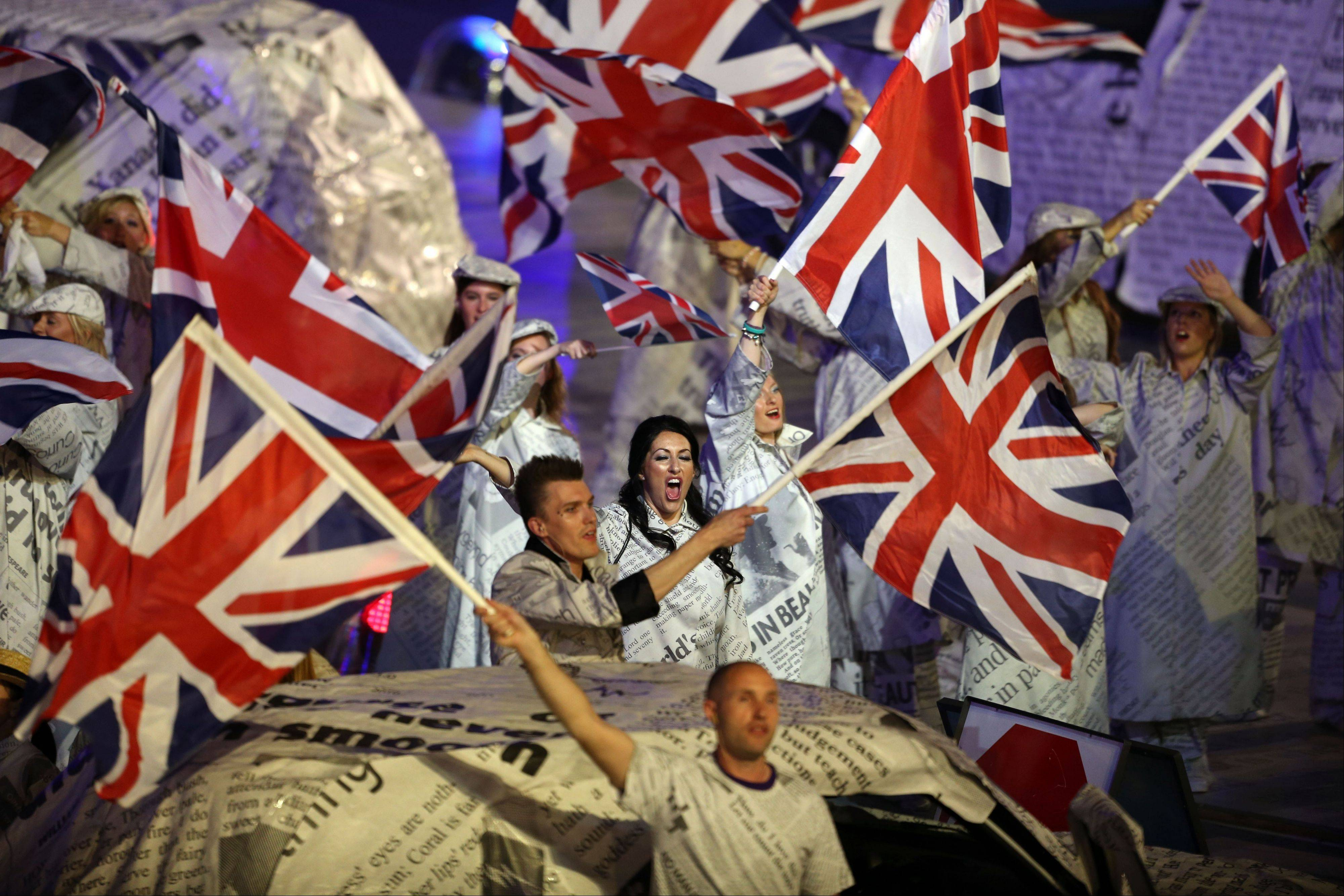 Performers wave the British flag during the Closing Ceremony at the 2012 Summer Olympics.