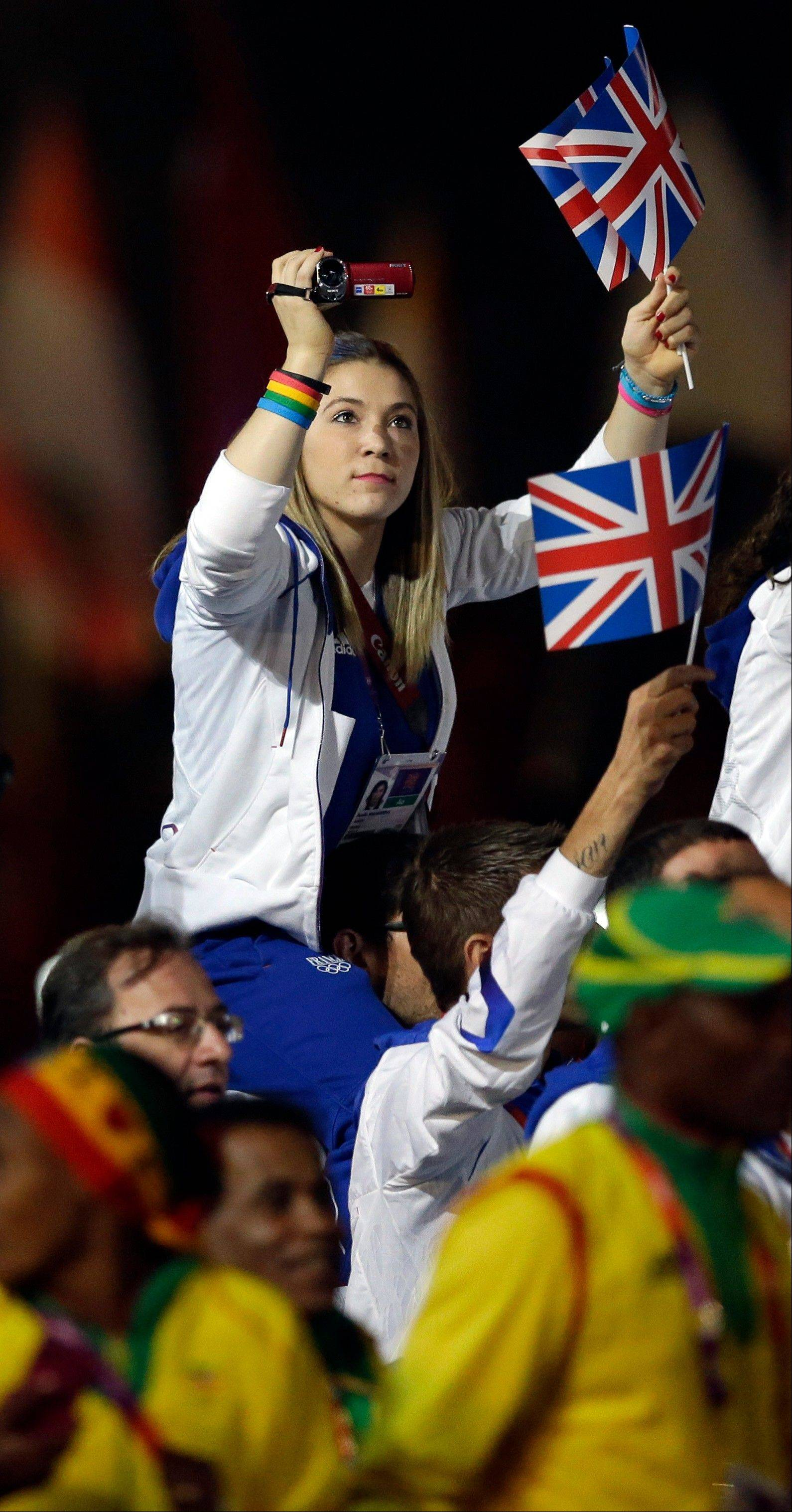 A member of the British team takes pictures during the Closing Ceremony at the 2012 Summer Olympics.