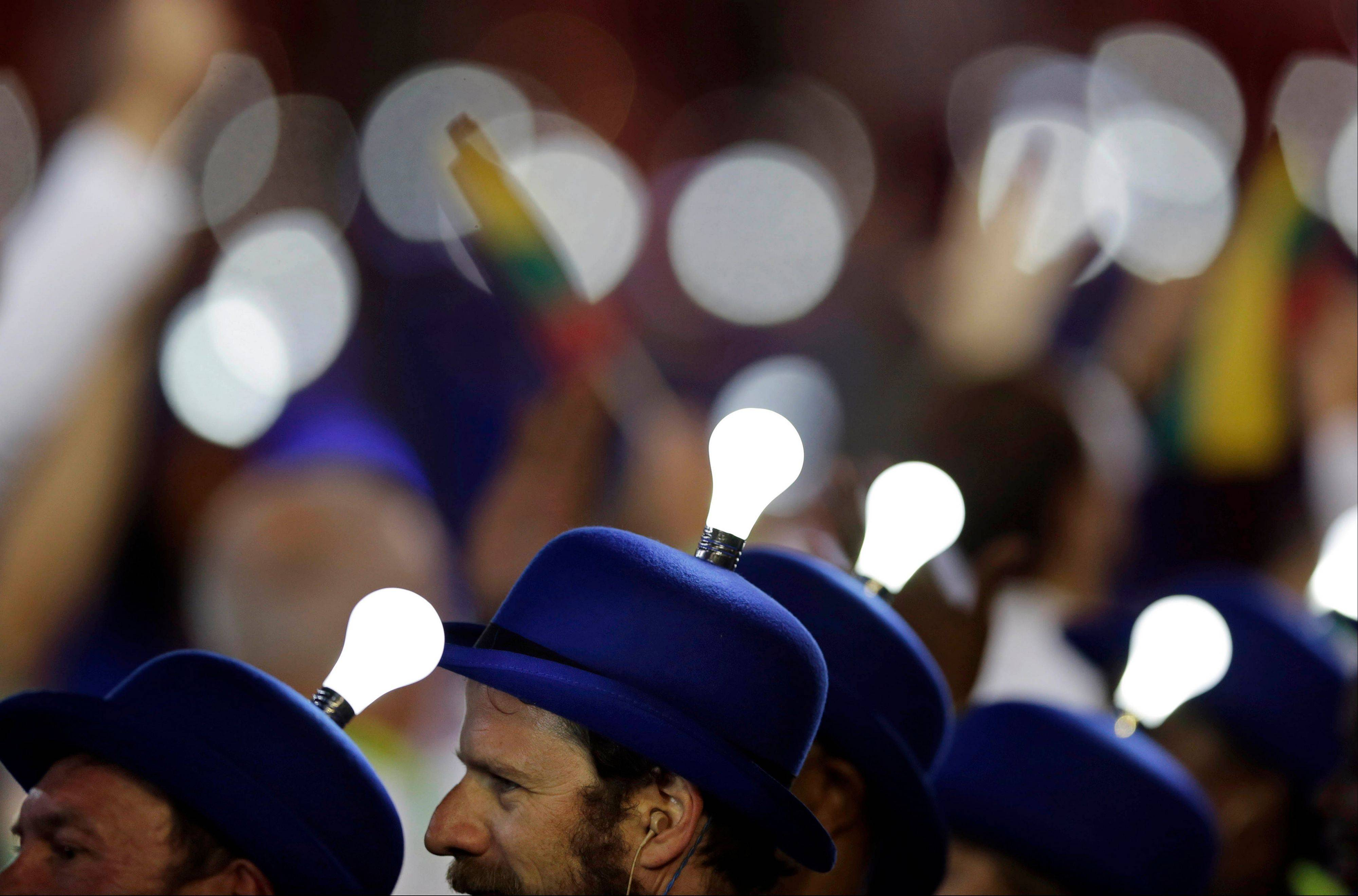 Light bulbs glow on the heads of performing artists during the Closing Ceremony at the 2012 Summer Olympics.