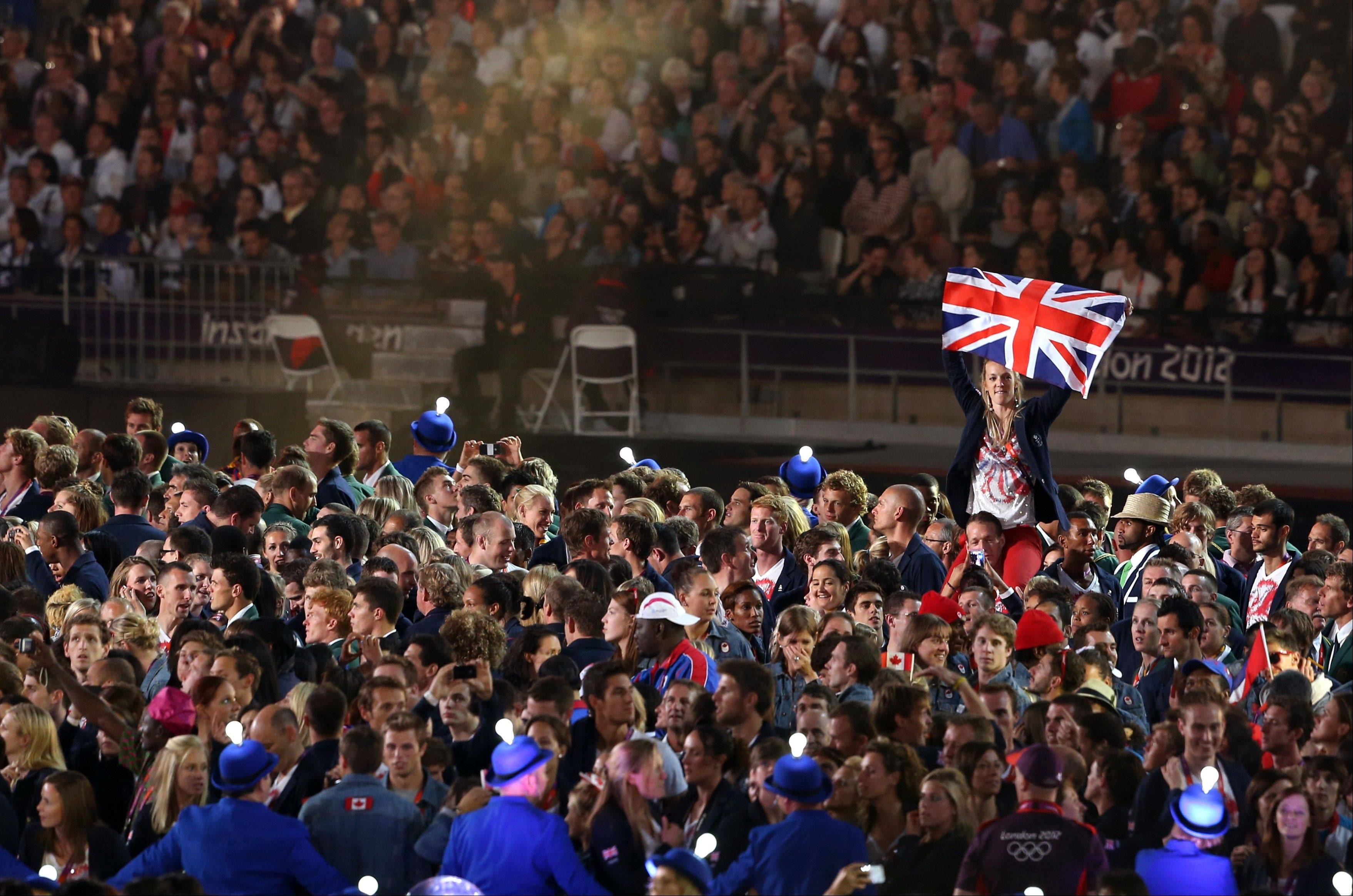 An athlete holds up the British flag during the Closing Ceremony at the 2012 Summer Olympics.