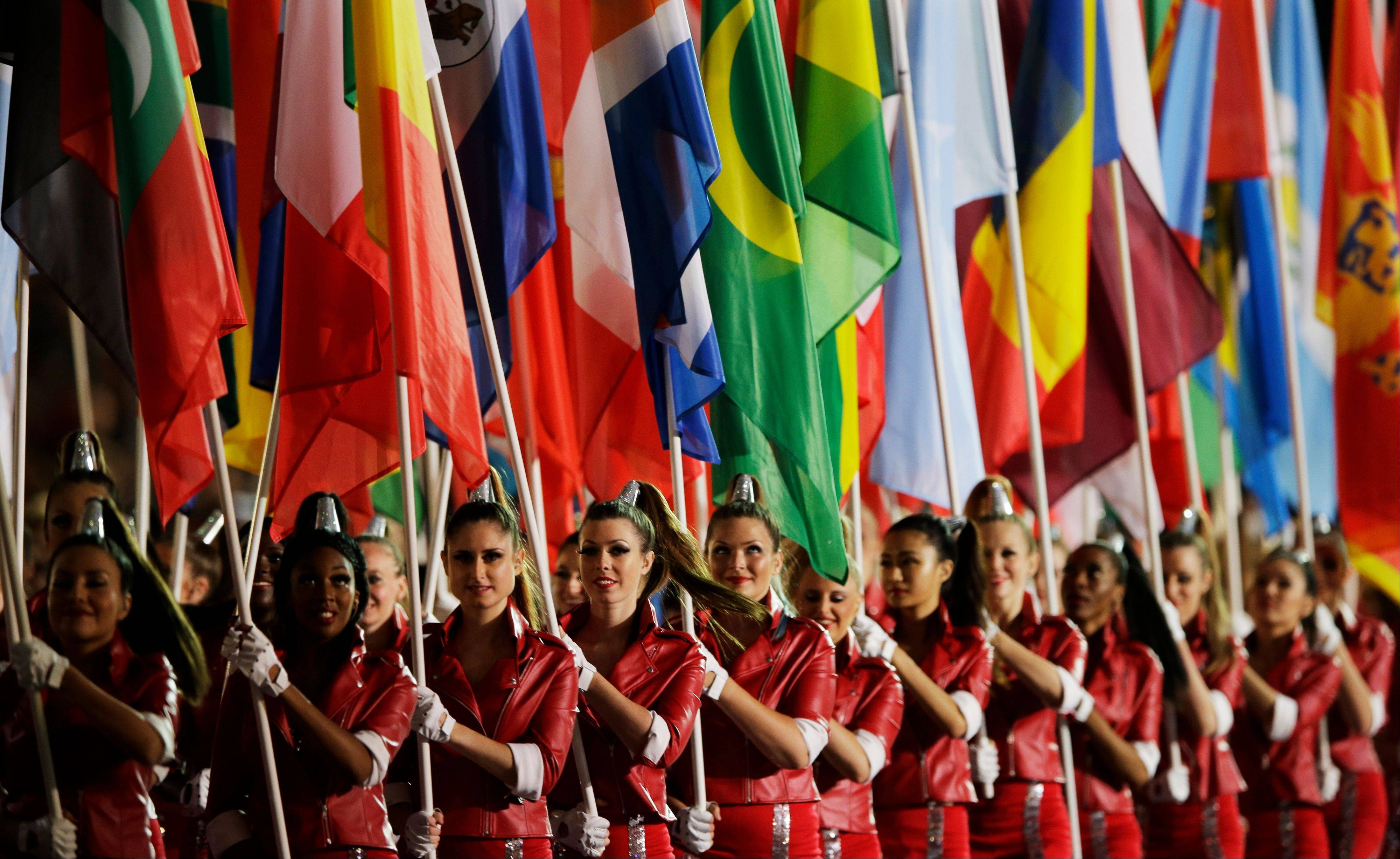 Flag bearers parade during the Closing Ceremony at the 2012 Summer Olympics.