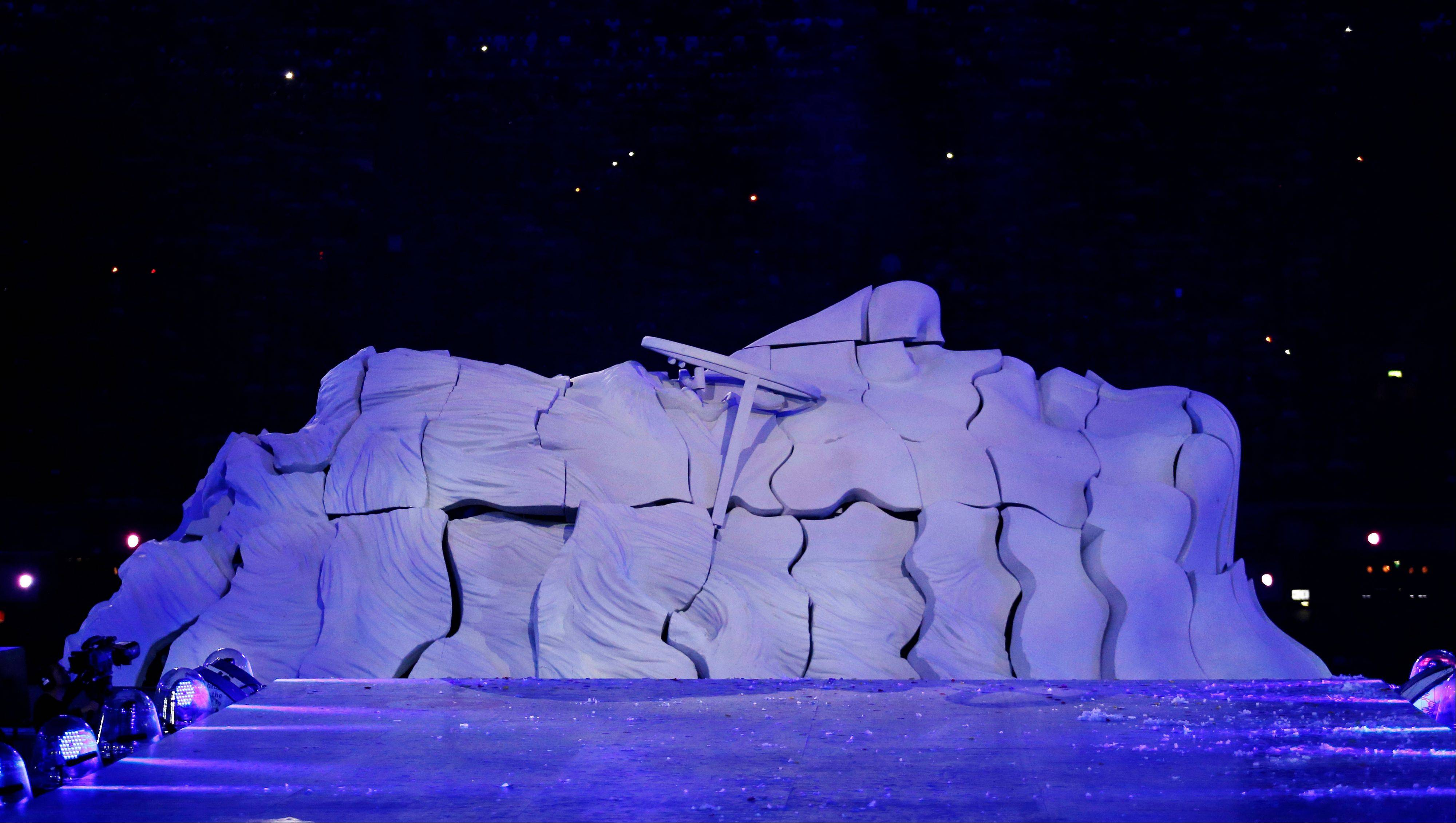 A sculpture in the shape of late Beatles band member John Lennon is seen during the Closing Ceremony at the 2012 Summer Olympics.