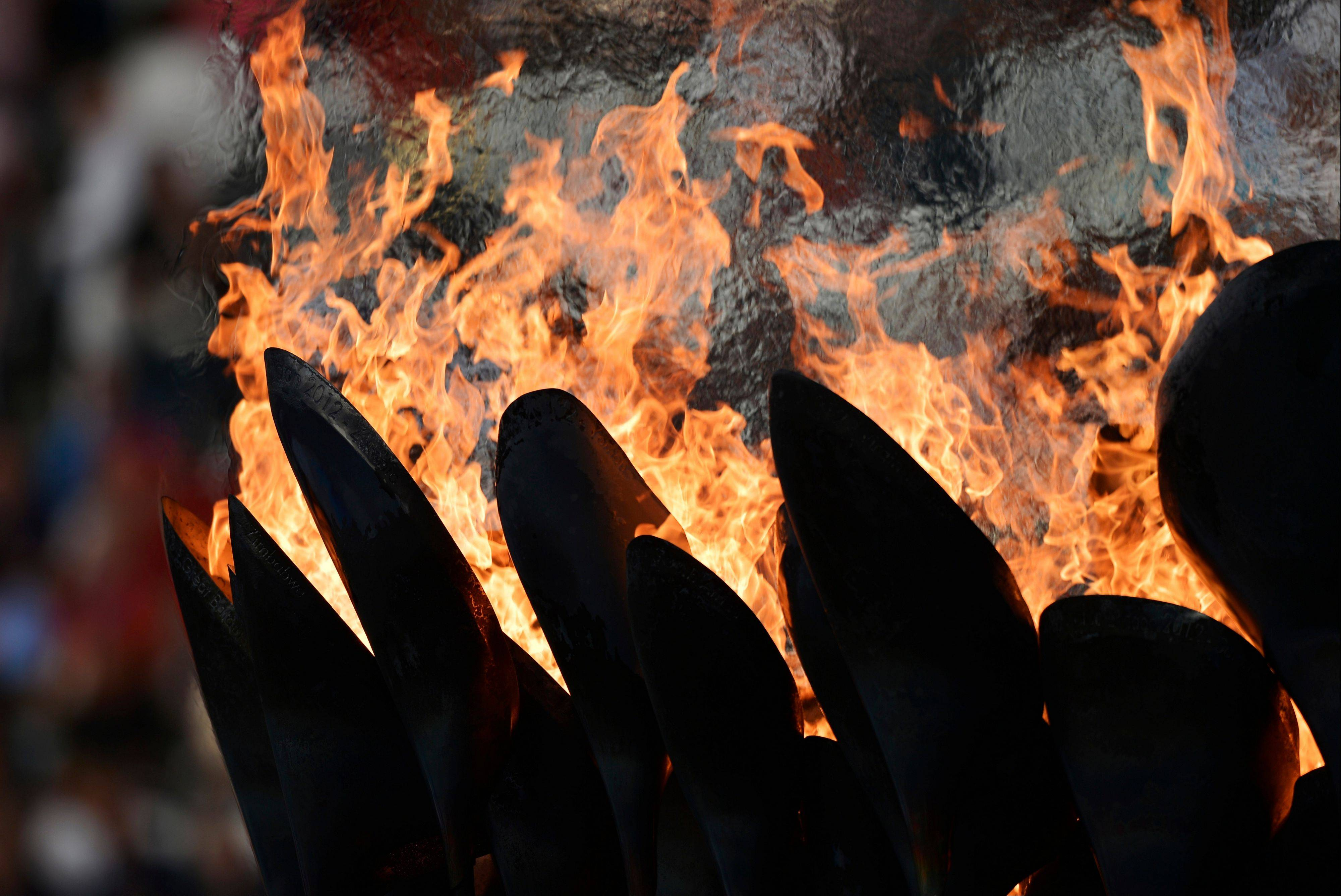 The Olympic flame burns in the Olympic Stadium before the start of the Closing Ceremony at the 2012 Summer Olympics.