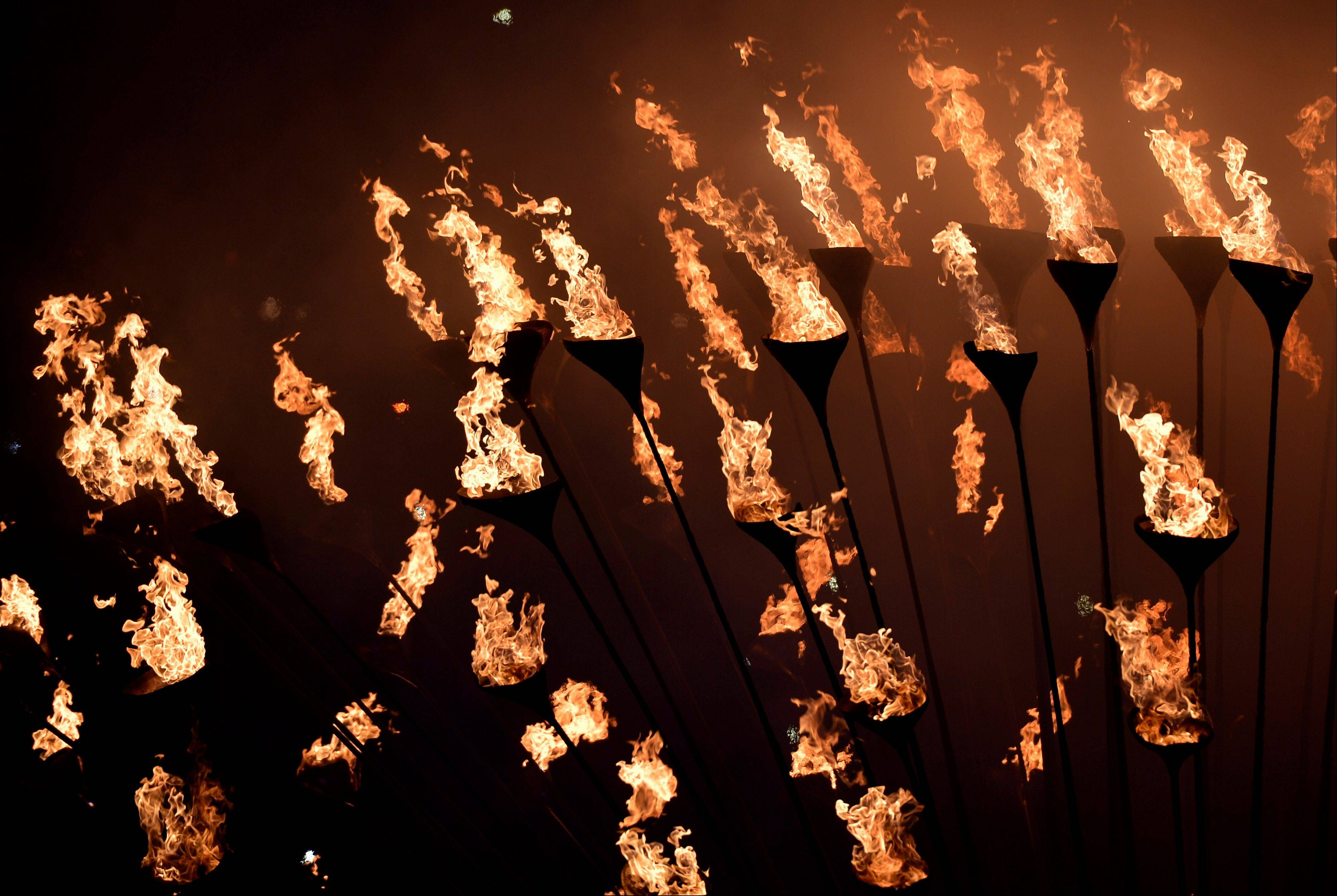 The cauldron burns during the Closing Ceremony at the 2012 Summer Olympics