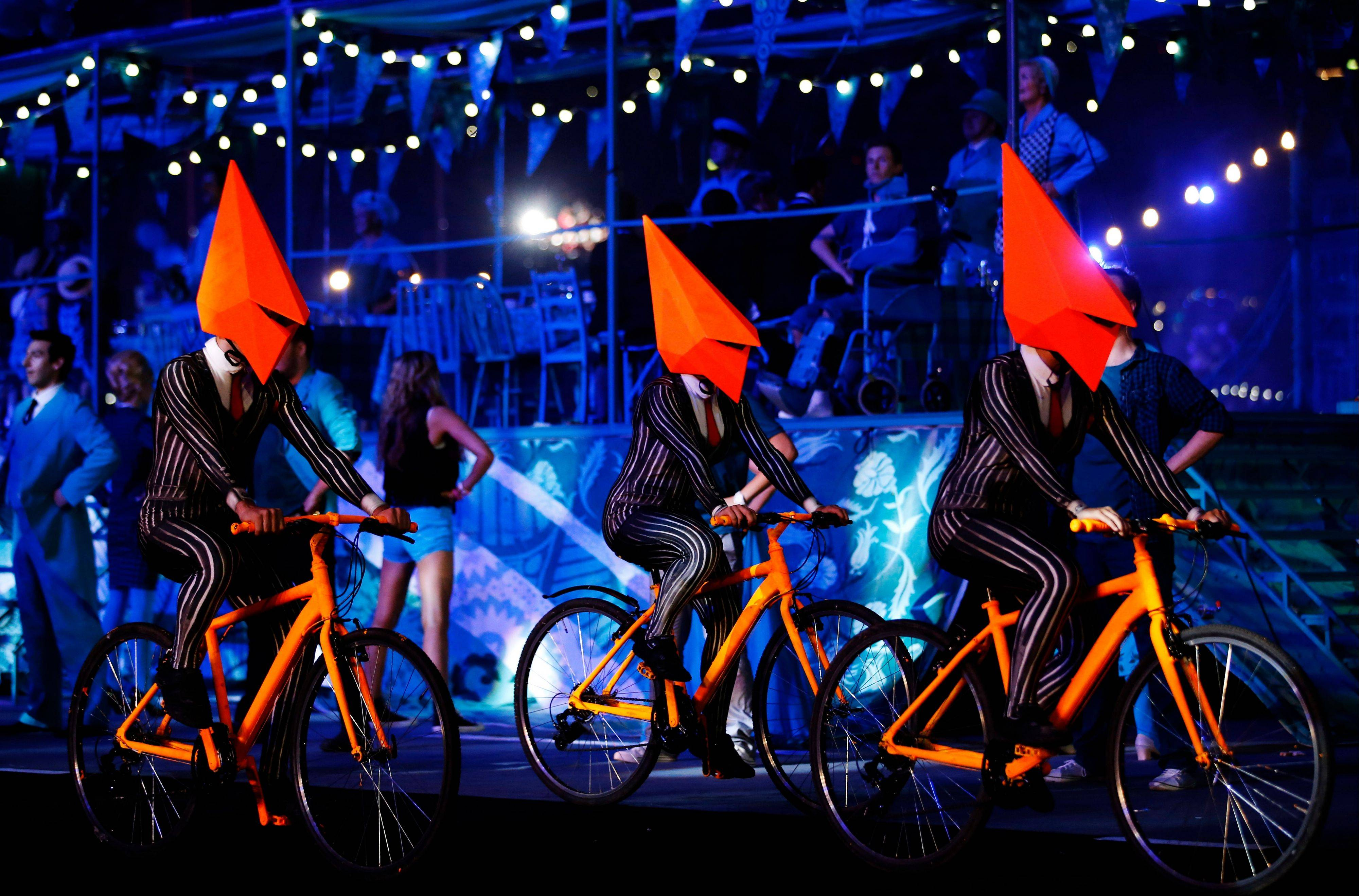 Performers cycle on the stage during the Closing Ceremony at the 2012 Summer Olympics.