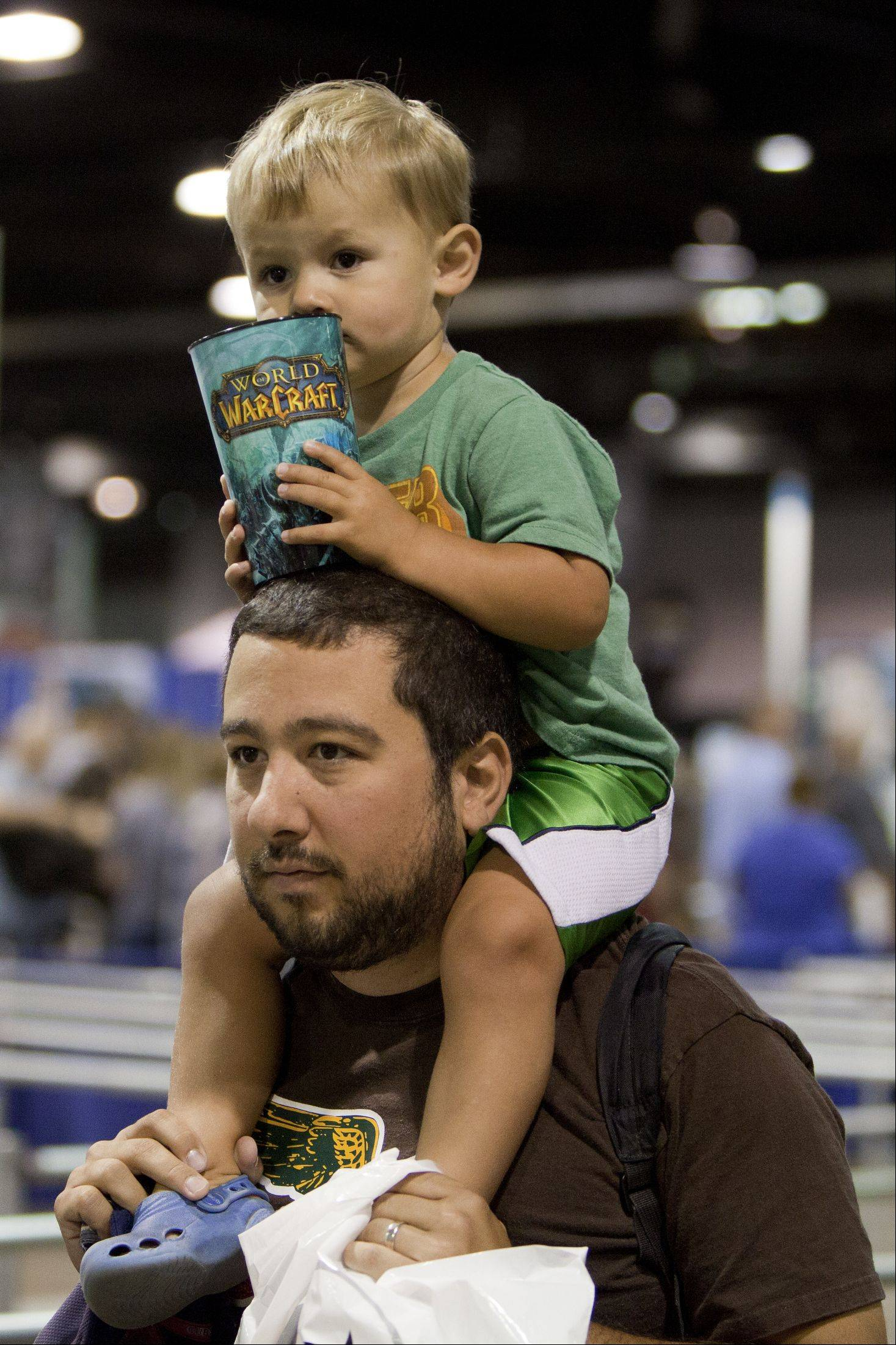 Derrick Burress of Schaumburg holds his two-year-old son Jackson as they explore the annual Wizard World Chicago Comic Con at the Donald E. Stephens Convention Center in Rosemont.