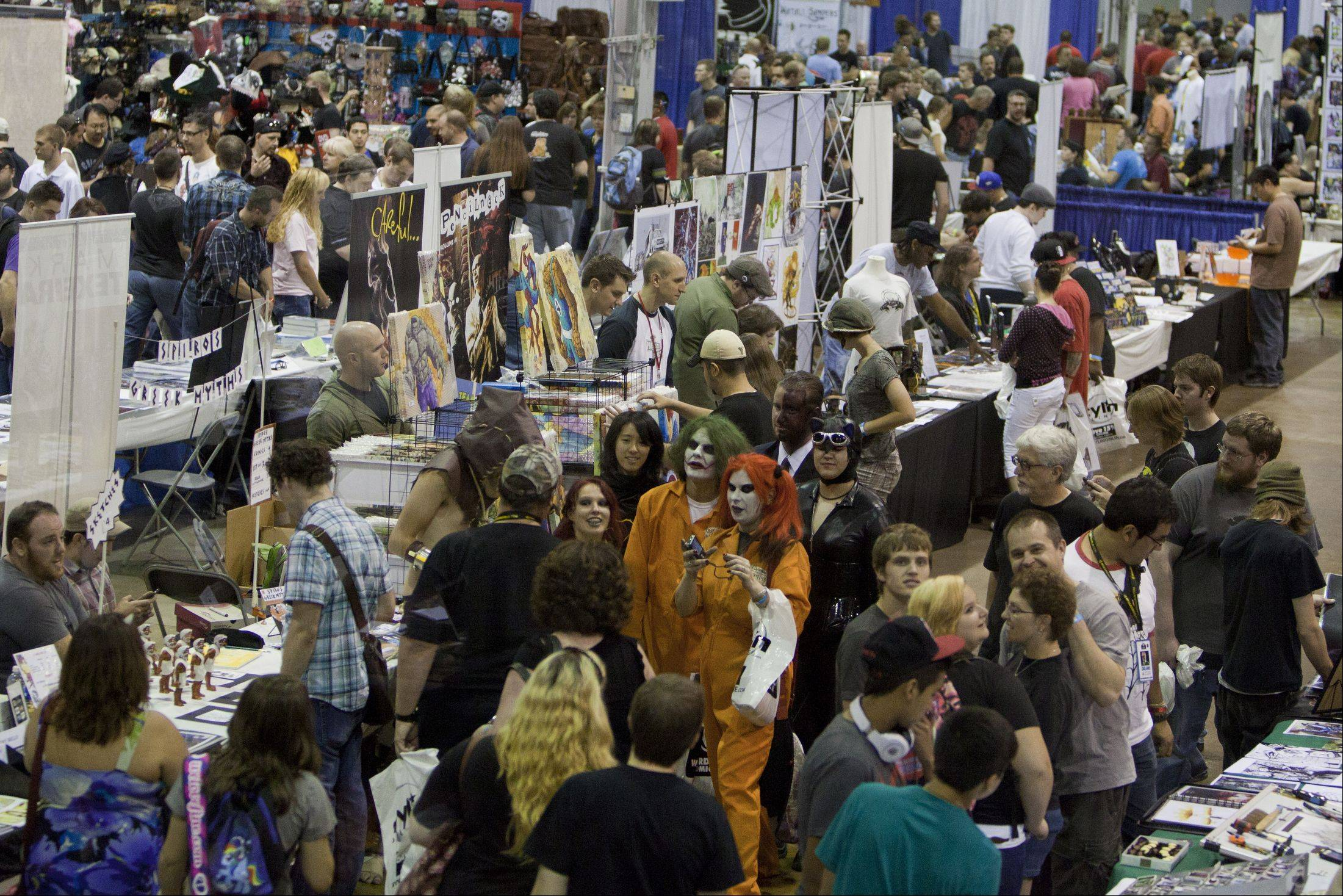 Thousands gather at the Donald E. Stephens Convention Center to be a part of annual Wizard World Chicago Comic Con. People could visit with comic book artists and buy all things that you would find in comics.
