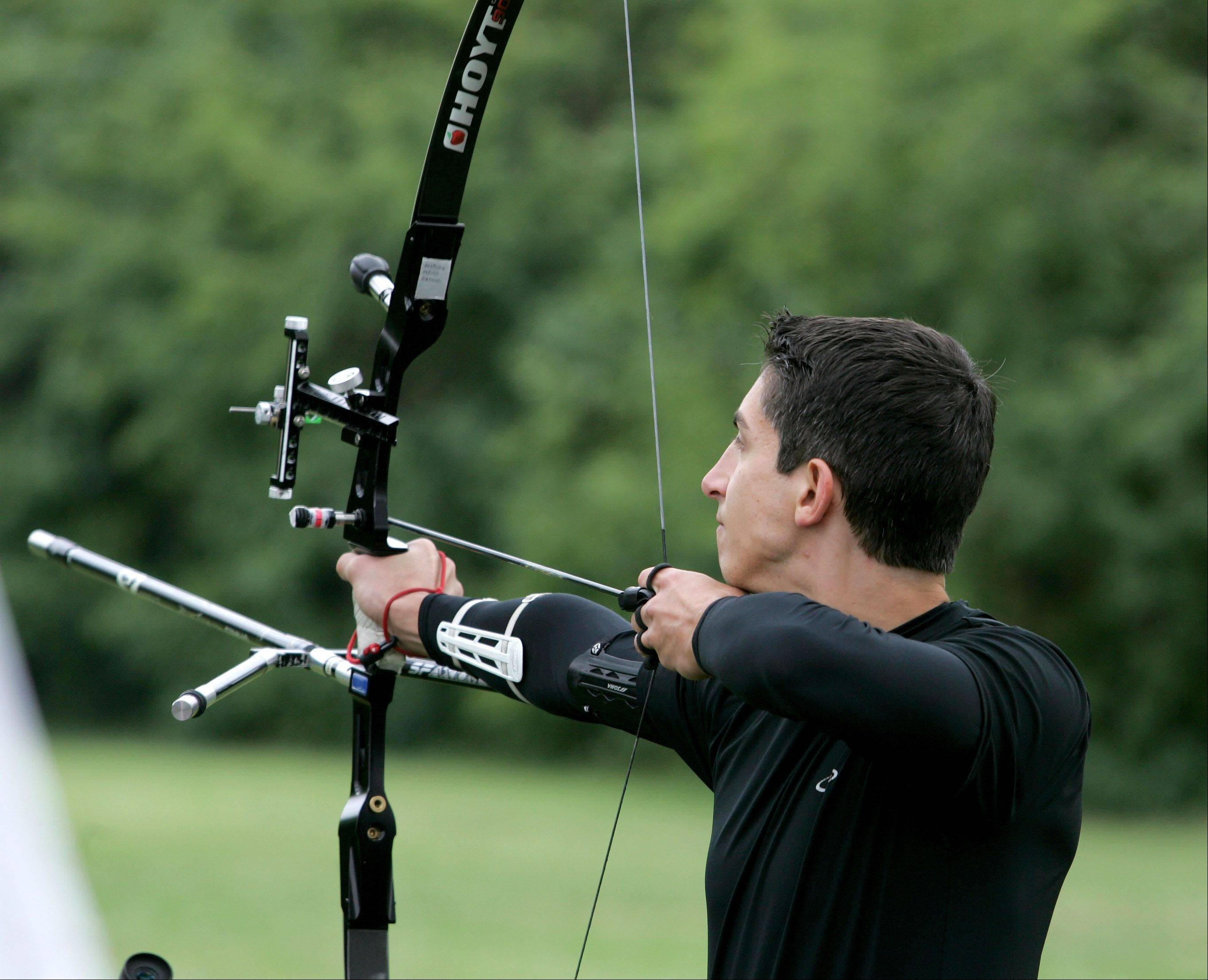 Dennis Timpanaro of Glen Ellyn competes with an Olympic recurve bow in the 900 metric round during the Illinois Target Archery Association's annual Outdoor State Championship at Wheaton Rifle Club in West Chicago on Sunday.