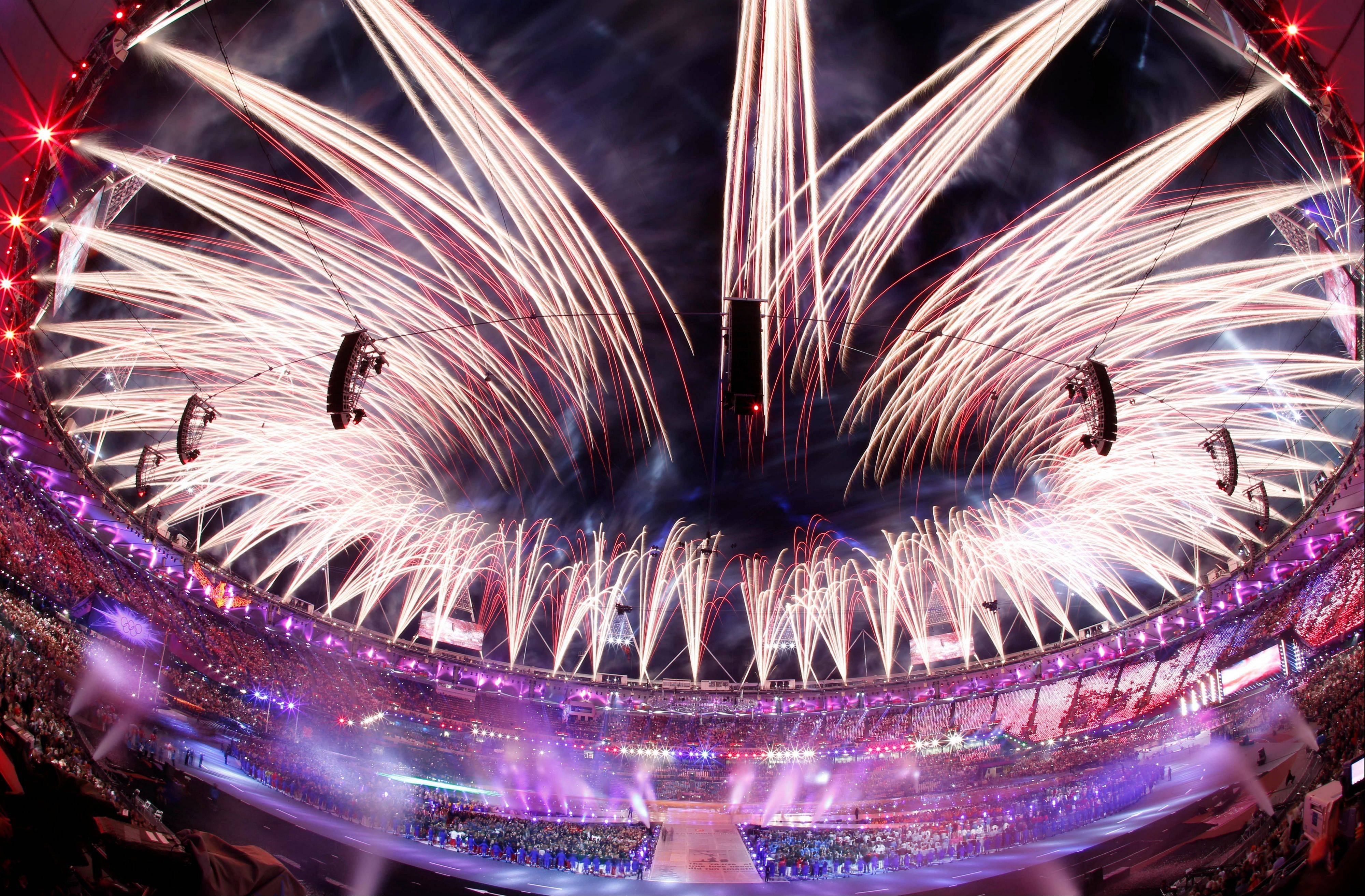 In this photo taken with a fisheye lens, pyrotechnics illuminate the sky above the Olympic Stadium during the Closing Ceremony at the 2012 Summer Olympics, Monday, Aug. 13, 2012, in London.