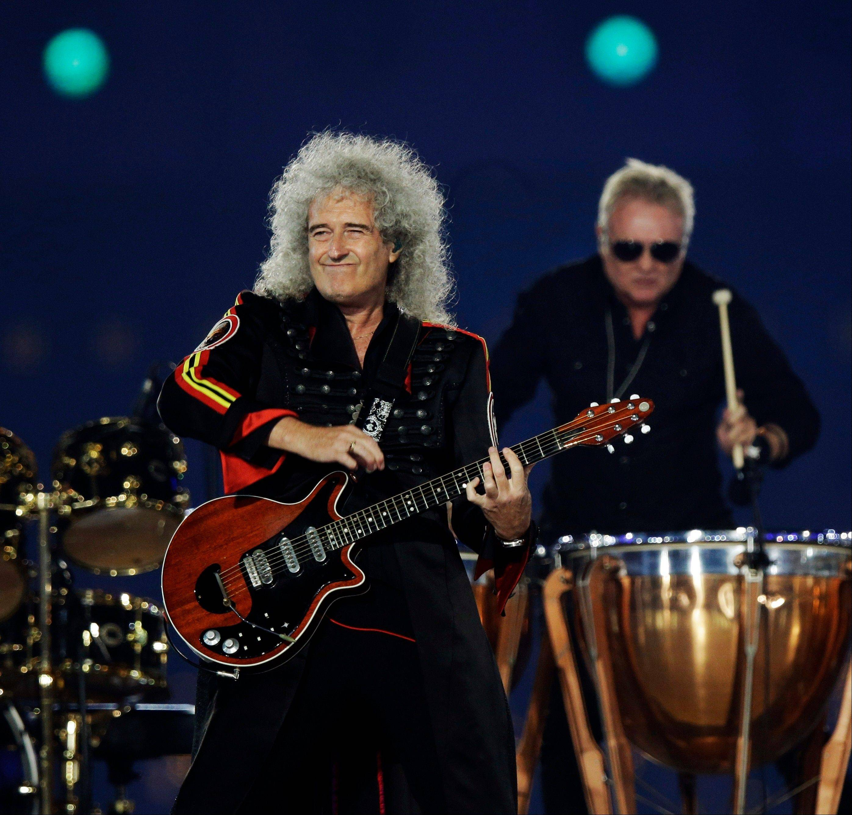 Queen guitarist Brian May performs during the Closing Ceremony at the 2012 Summer Olympics, Sunday, Aug. 12, 2012, in London.