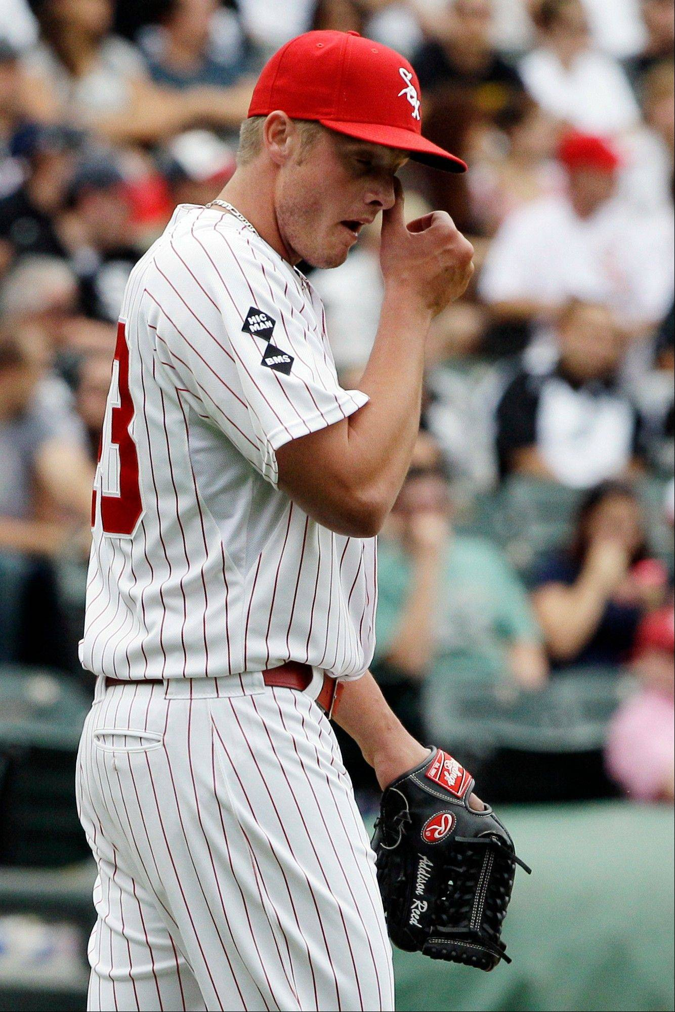 White Sox closer Addison Reed wipes his eyes after Oakland Athletics' Derek Norris hit a solo home run during the ninth inning of a baseball game in Chicago, Sunday, Aug. 12, 2012. The White Sox won 7-3.