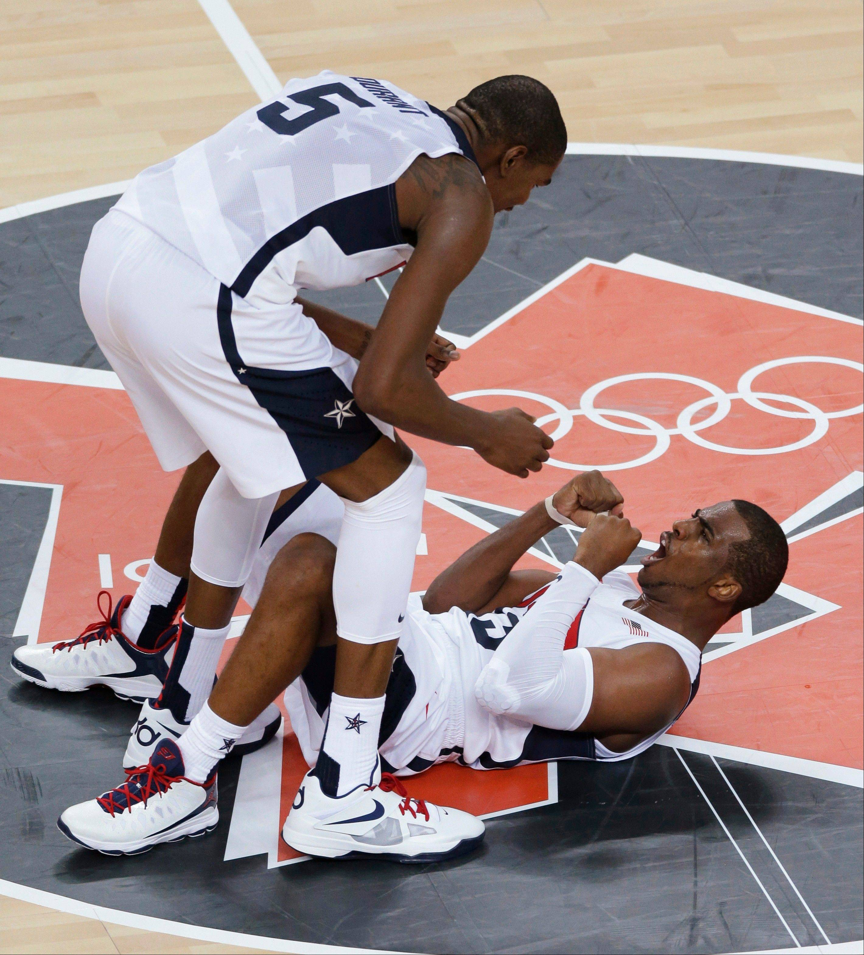 United States' Kevin Durant and Chris Paul celebrate during the men's gold medal basketball game against Spain at the 2012 Summer Olympics Sunday in London. The United States defeated Spain 107-100 to win the gold medal.