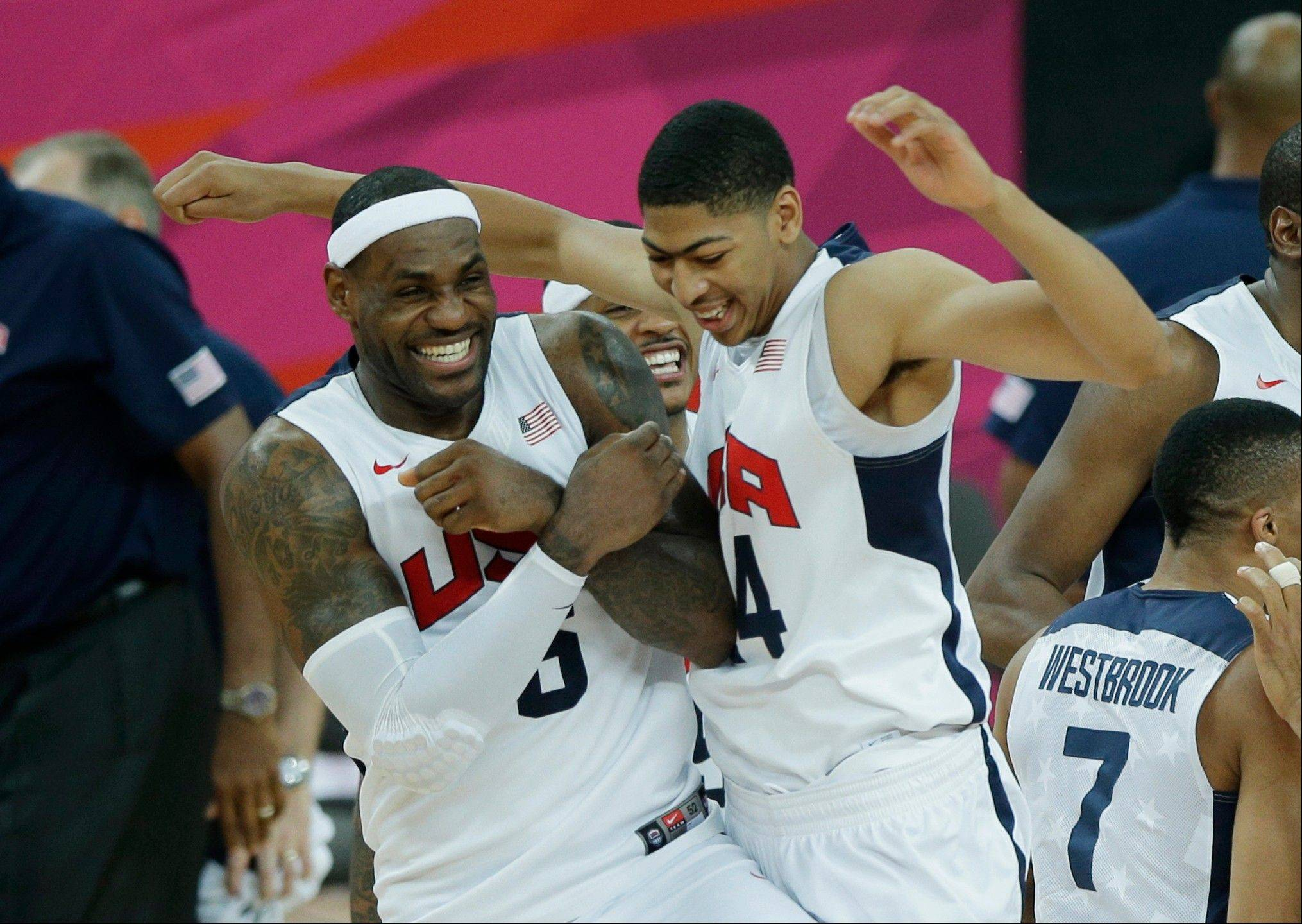 United States' LeBron James, left, and Tyson Chandler celebrate after defeating Spain, 107-100, to win the men's gold medal basketball game at the 2012 Summer Olympics Sunday in London.