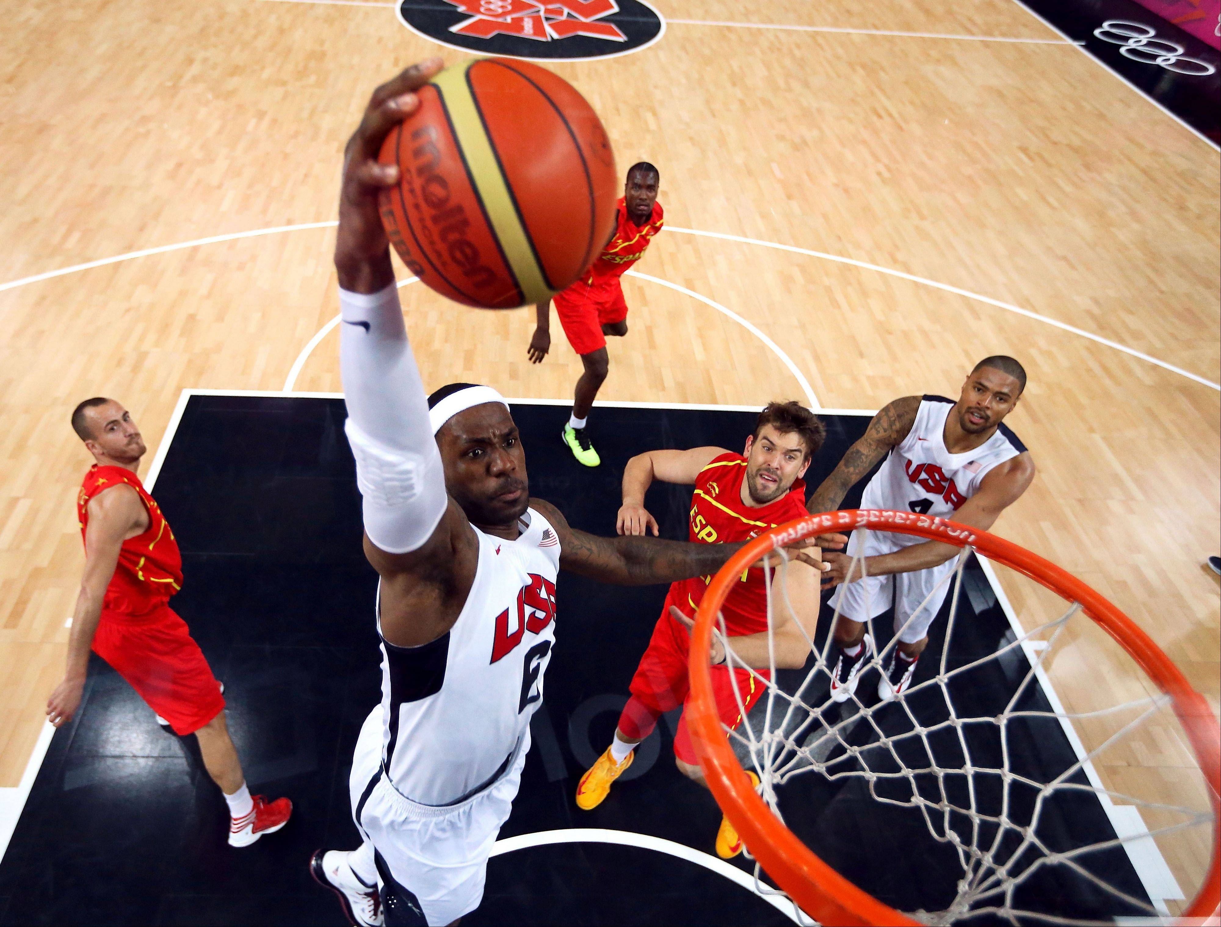 United States' LeBron James dunks against Spain during the men's gold medal basketball game at the 2012 Summer Olympics in London on Sunday.